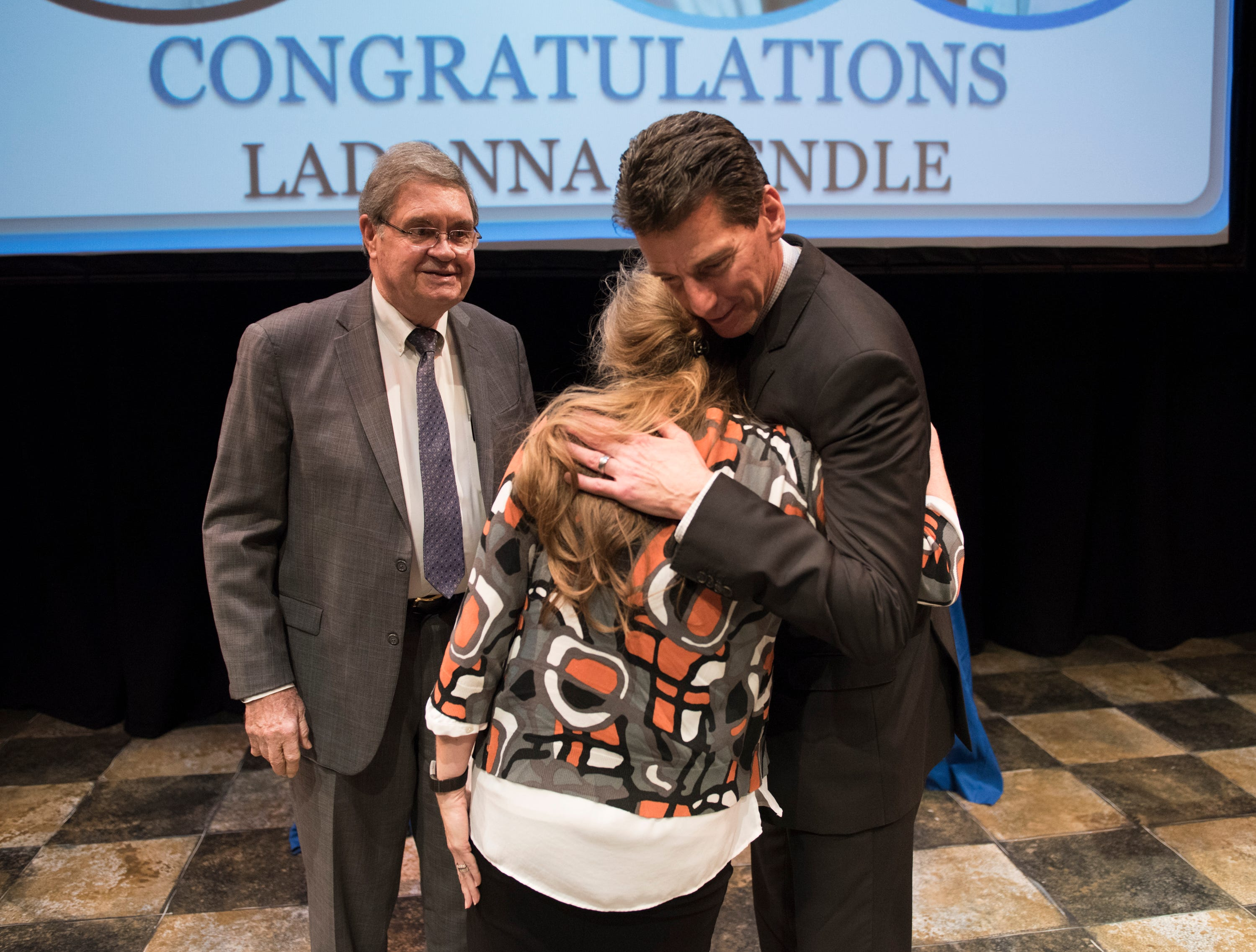 LaDonna Brendle hugs Montgomery Advertiser publisher Michael Galvin as she his awarded the Community Hero of the year award during the Community Heroes awards ceremony at Alabama Shakespeare Festival in Montgomery, Ala., on Tuesday, Jan. 8, 2019.