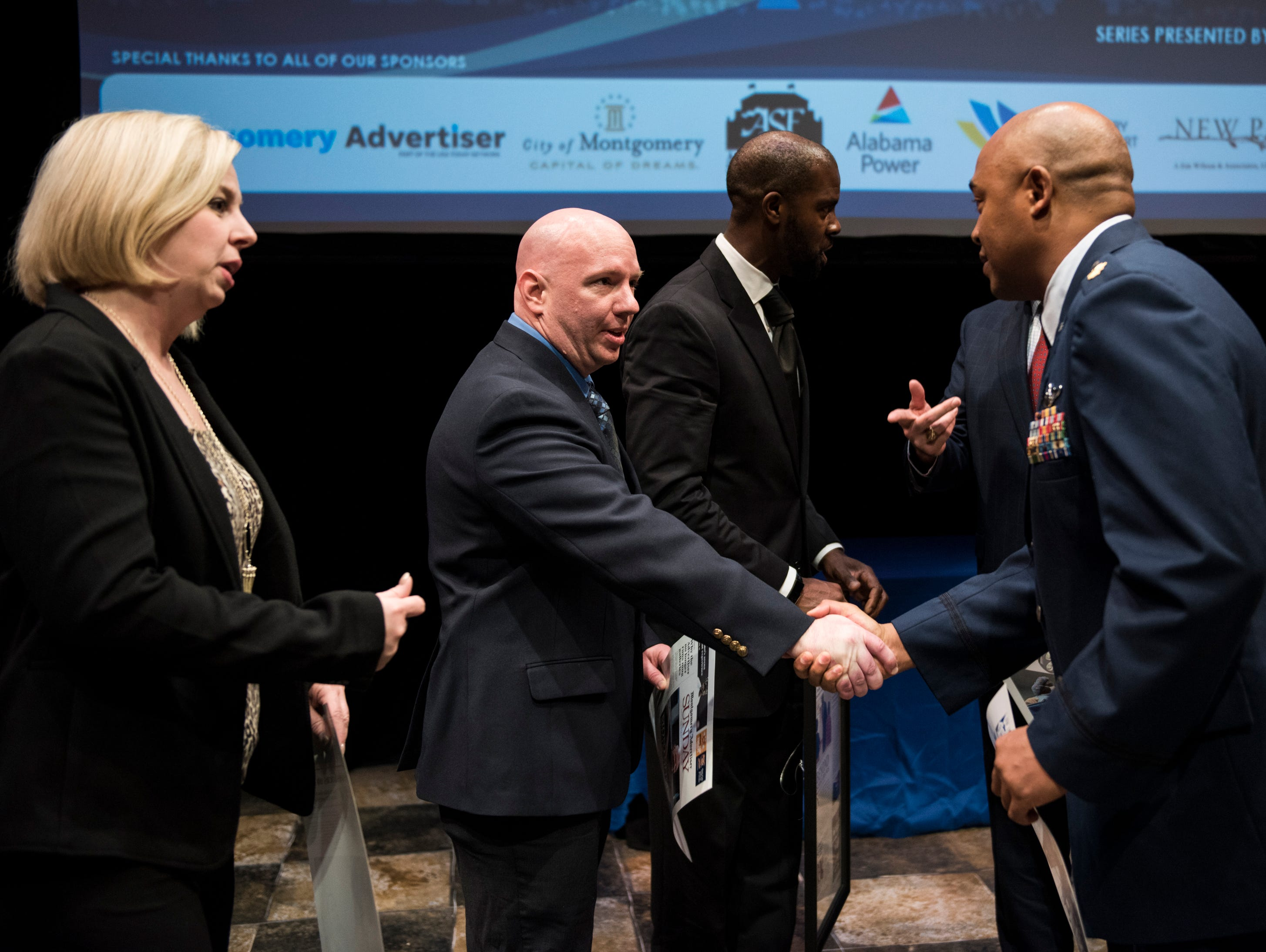 Community Heroes detective Bryan Goza and Maj.Rich Peace shake hands during the Community Heroes awards ceremony at Alabama Shakespeare Festival in Montgomery, Ala., on Tuesday, Jan. 8, 2019.