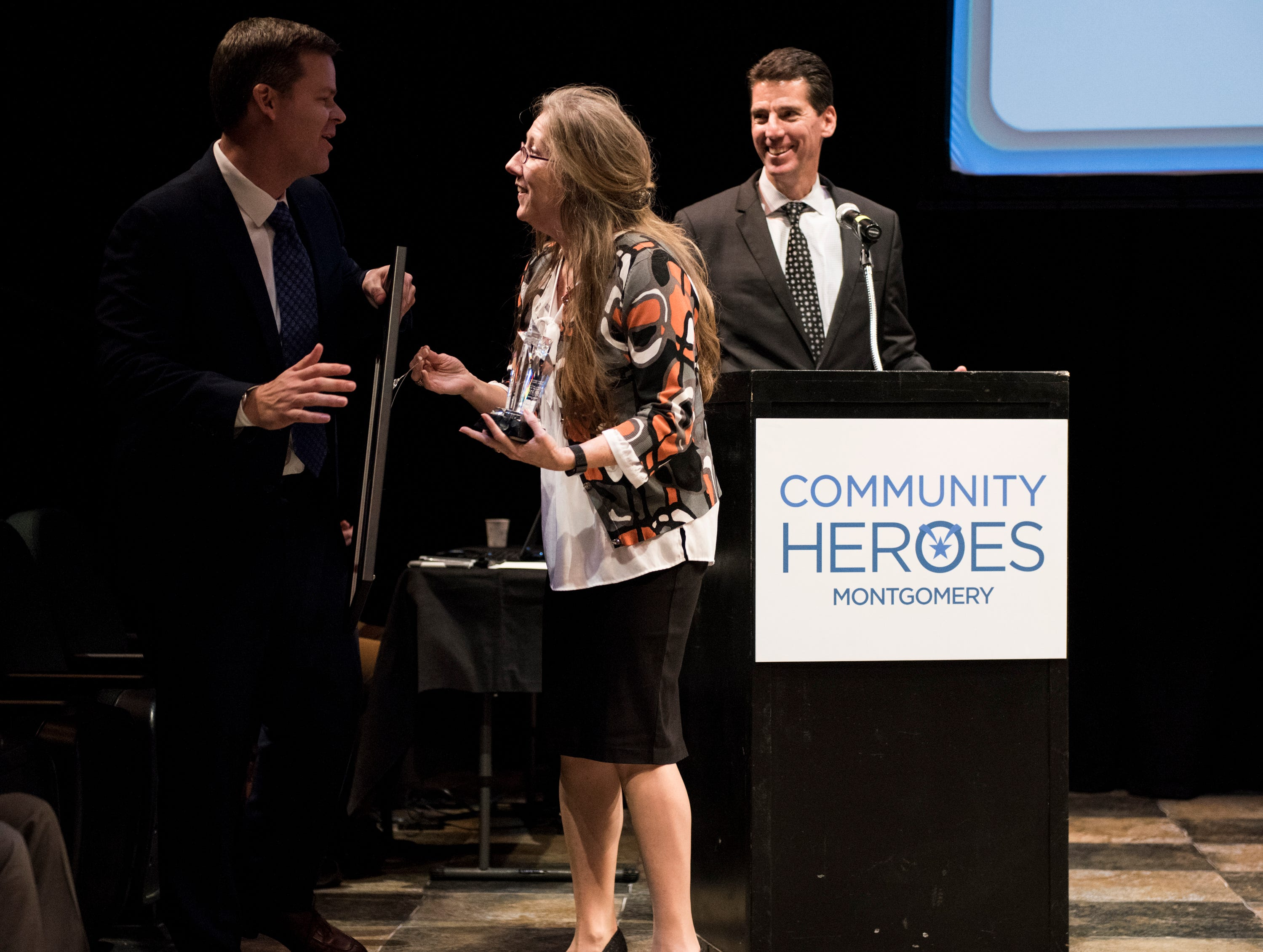Montgomery Advertiser executive editor Bro Krift congratulates Community Hero of the year LaDonna Brendle during the Community Heroes awards ceremony at Alabama Shakespeare Festival in Montgomery, Ala., on Tuesday, Jan. 8, 2019.