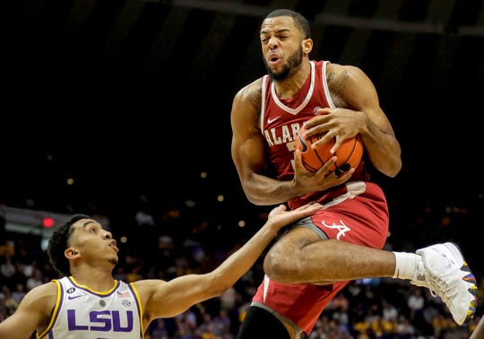 Jan 8, 2019; Baton Rouge, LA, USA; Alabama Crimson Tide forward Galin Smith (30) rebounds over LSU Tigers guard Tremont Waters (3) during the first half at the Maravich Assembly Center. Mandatory Credit: Derick E. Hingle-USA TODAY Sports