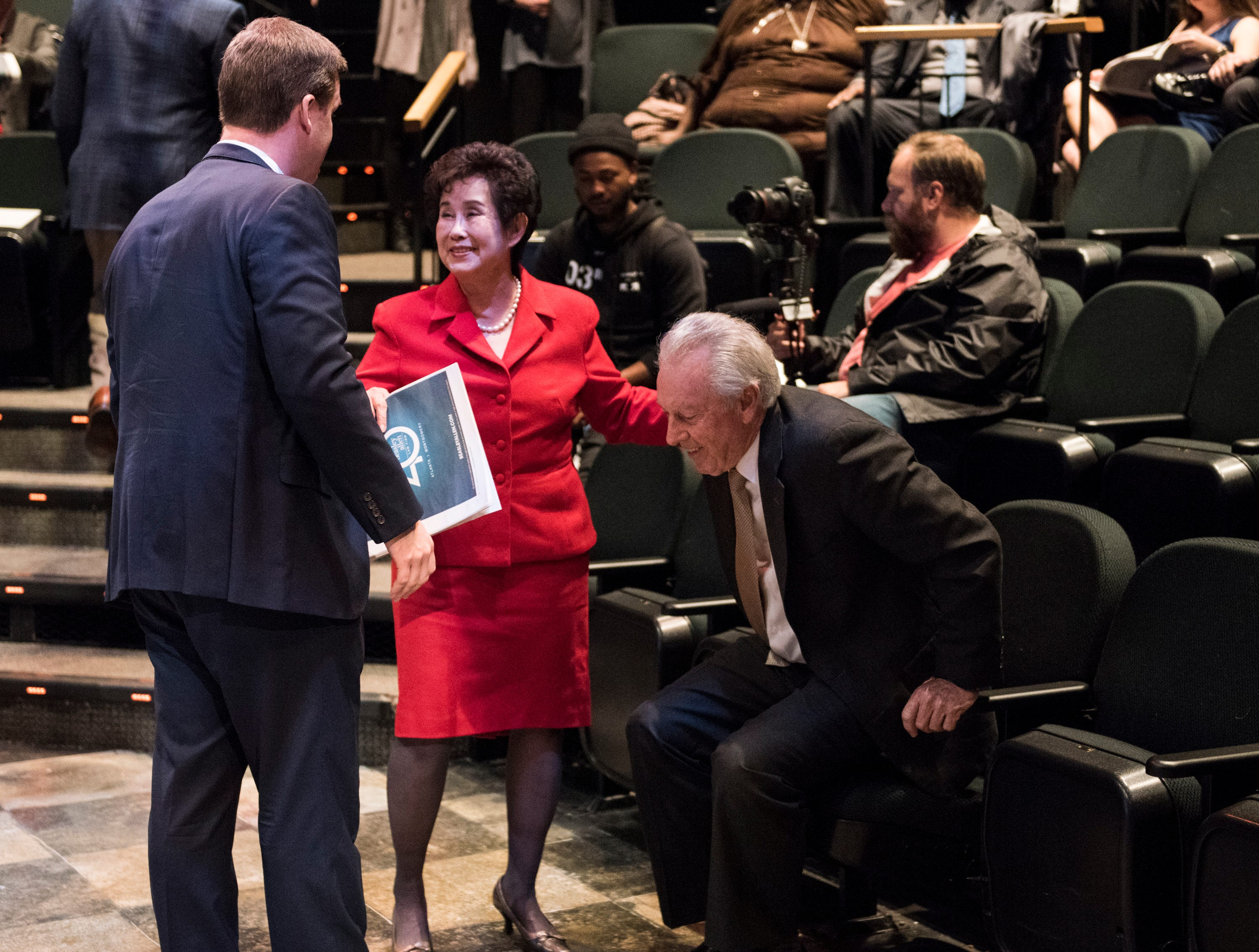 Montgomery Advertiser executive editor Bro Krift greets Community Hero Sieu Tang Wood during the Community Heroes awards ceremony at Alabama Shakespeare Festival in Montgomery, Ala., on Tuesday, Jan. 8, 2019.