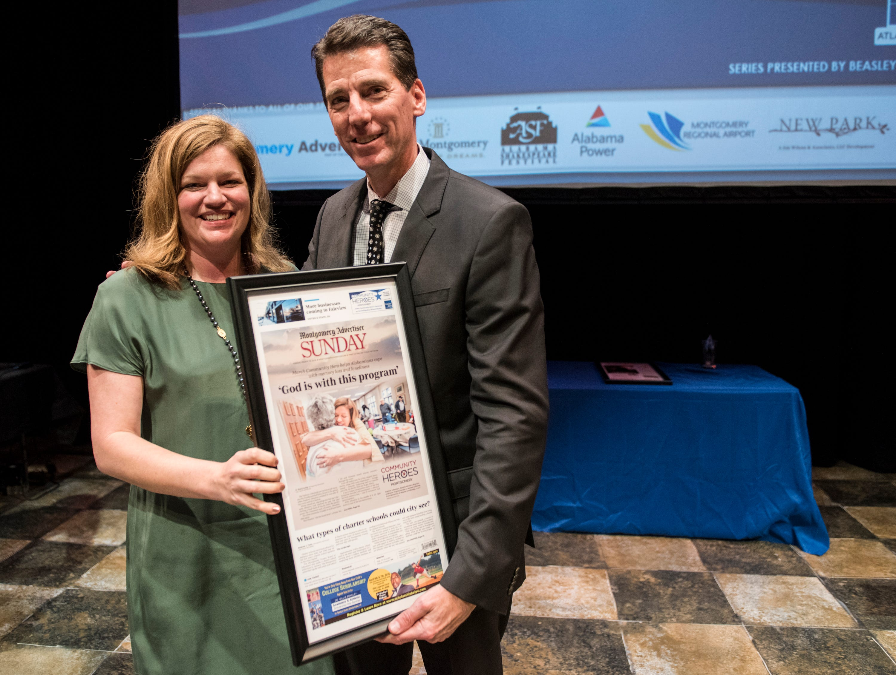 Community Hero Daphne Johnston and Montgomery Advertiser publisher Michael Galvin pose for a picture during the Community Heroes awards ceremony at Alabama Shakespeare Festival in Montgomery, Ala., on Tuesday, Jan. 8, 2019.