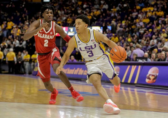 Jan 8, 2019; Baton Rouge, LA, USA; LSU Tigers guard Tremont Waters (3) drives past Alabama Crimson Tide guard Kira Lewis Jr. (2) during the second half at the Maravich Assembly Center. Mandatory Credit: Derick E. Hingle-USA TODAY Sports