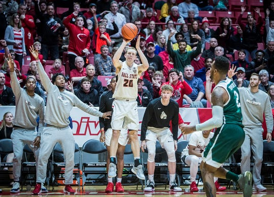 Ball State's Austin Nehls ties the game with a 3-pointer at the end of the first overtime against Eastern Michigan at Worthen Arena Tuesday, Jan. 8, 2019.