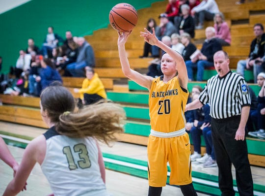 Cowan's Lauren Smith shoots past Daleville's defense during their game at Yorktown High School Tuesday, Jan. 8, 2019.