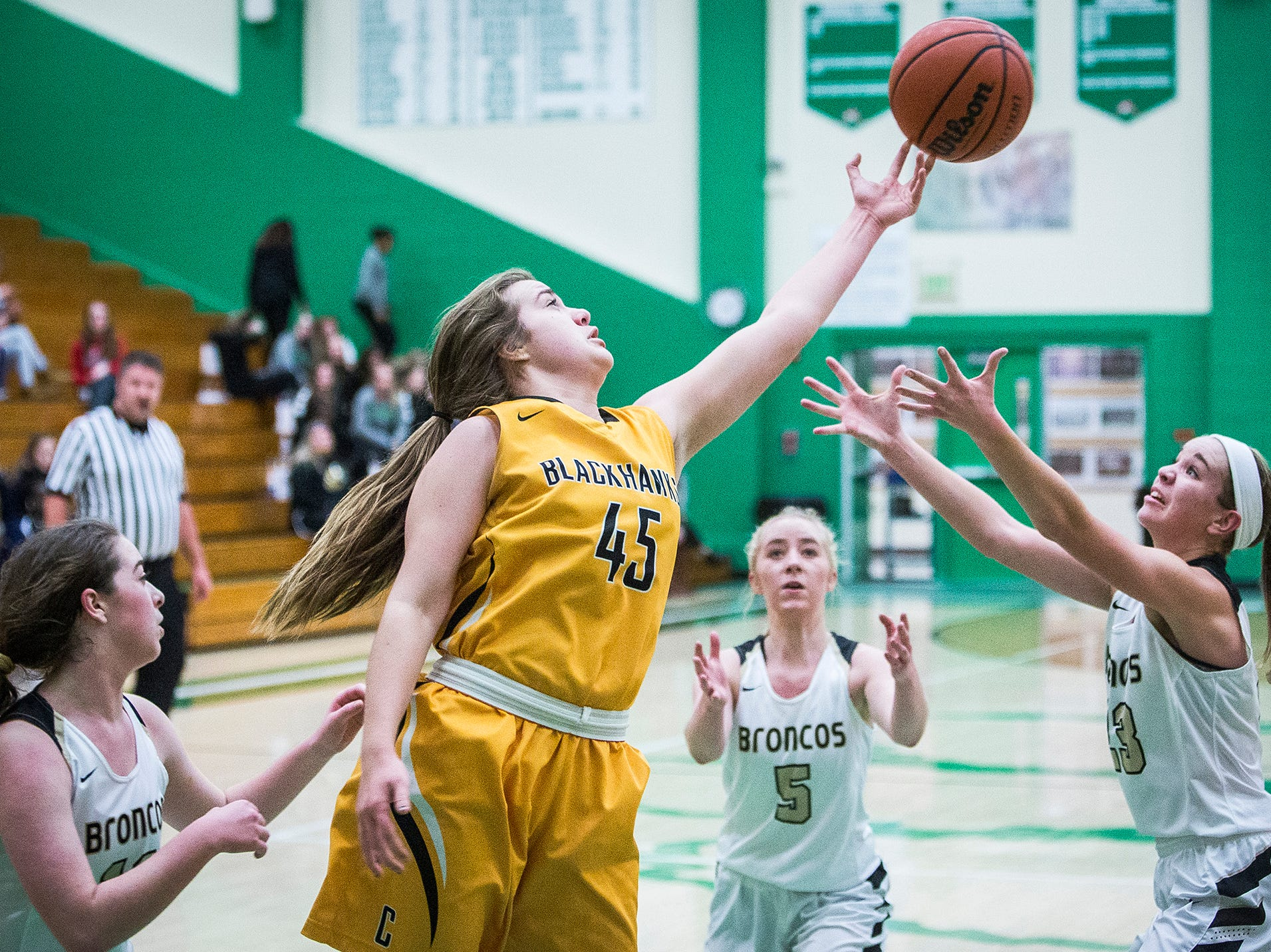 Cowan's Emma Johnson grabs a rebound past Daleville's defense during their game at Yorktown High School Tuesday, Jan. 8, 2019.