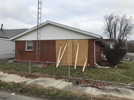 Authorities said a house in the 1100 block of South Penn Street was damaged Sunday evening when a SUV being pursued by police crashed into its south wall. The driver, Brion Darnell Sharp, allegedly then tried to flee on foot but was captured.