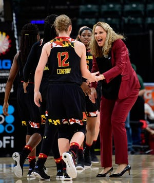 Mar 4, 2018; Indianapolis, IN, USA; Maryland Terrapins head coach Brenda Frese high fives guard Kristen Confroy (12) during a timeout in the first half of the championship game during the Big Ten Conference Tournament against the Ohio State Buckeyes at Bankers Life Fieldhouse. Mandatory Credit: Marc Lebryk-USA TODAY Sports