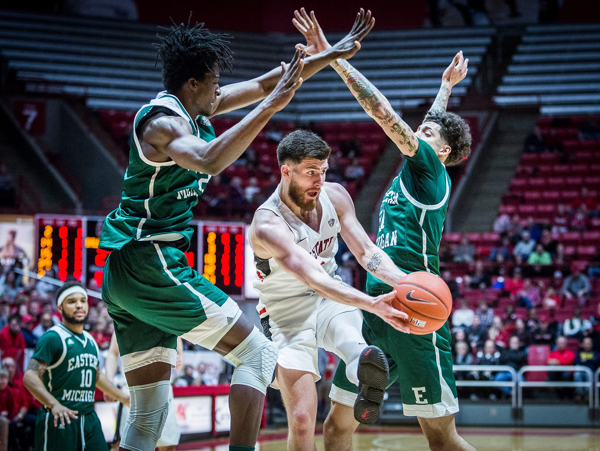 Ball State's Tayler Persons passes past Eastern Michigan's defense during their game at Worthen Arena Tuesday, Jan. 8, 2019.
