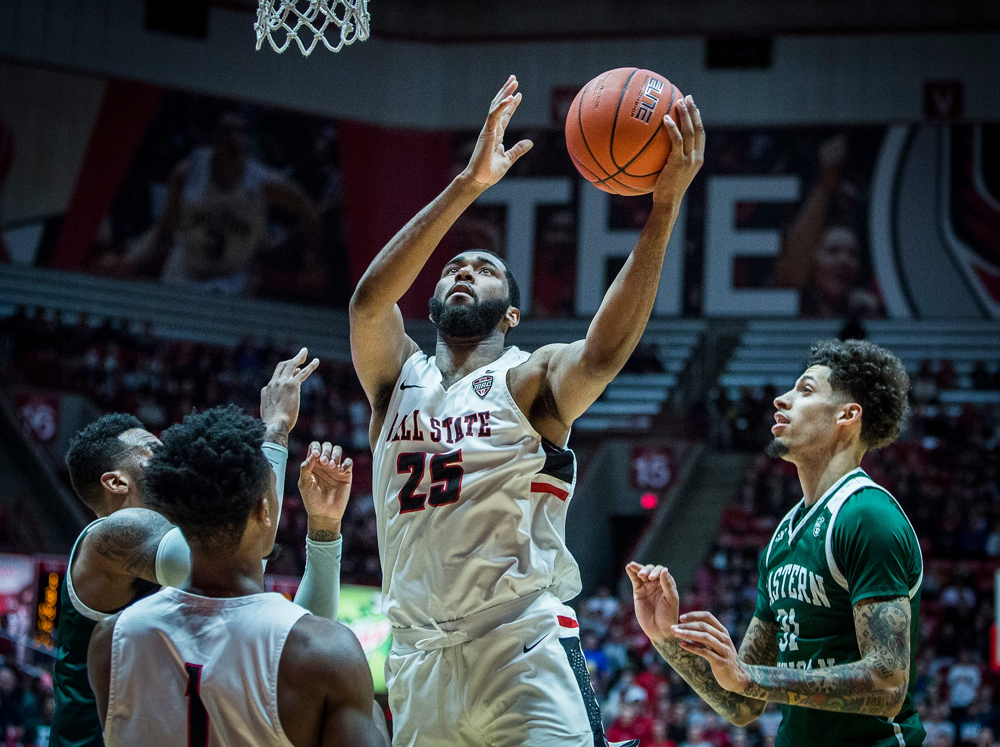 Ball State's Tahjai Teague shoots past Eastern Michigan's defense during their game at Worthen Arena Tuesday, Jan. 8, 2019.