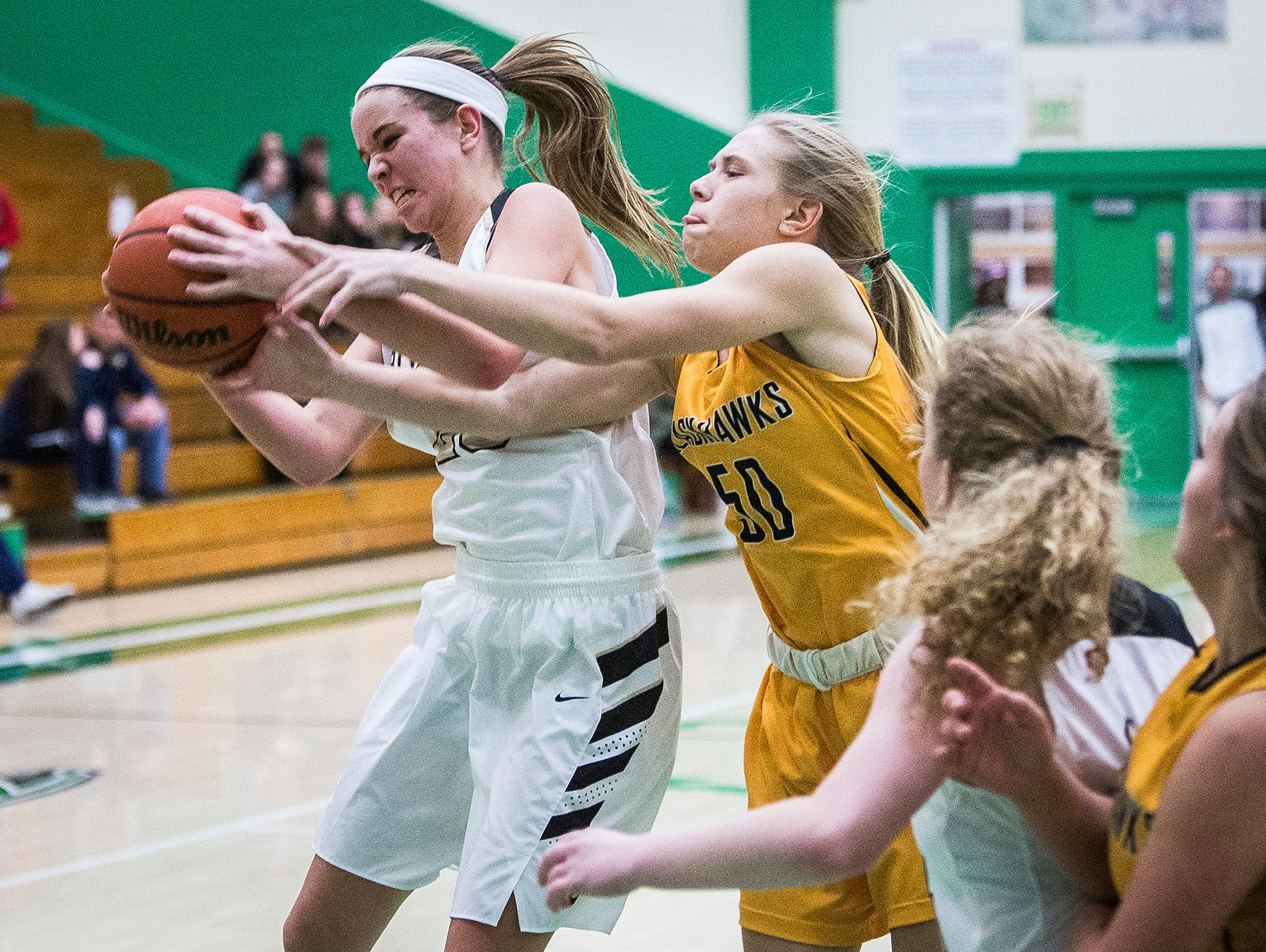 Daleville's Eve Emery battles for possession against Cowan during their game at Yorktown High School Tuesday, Jan. 8, 2019.