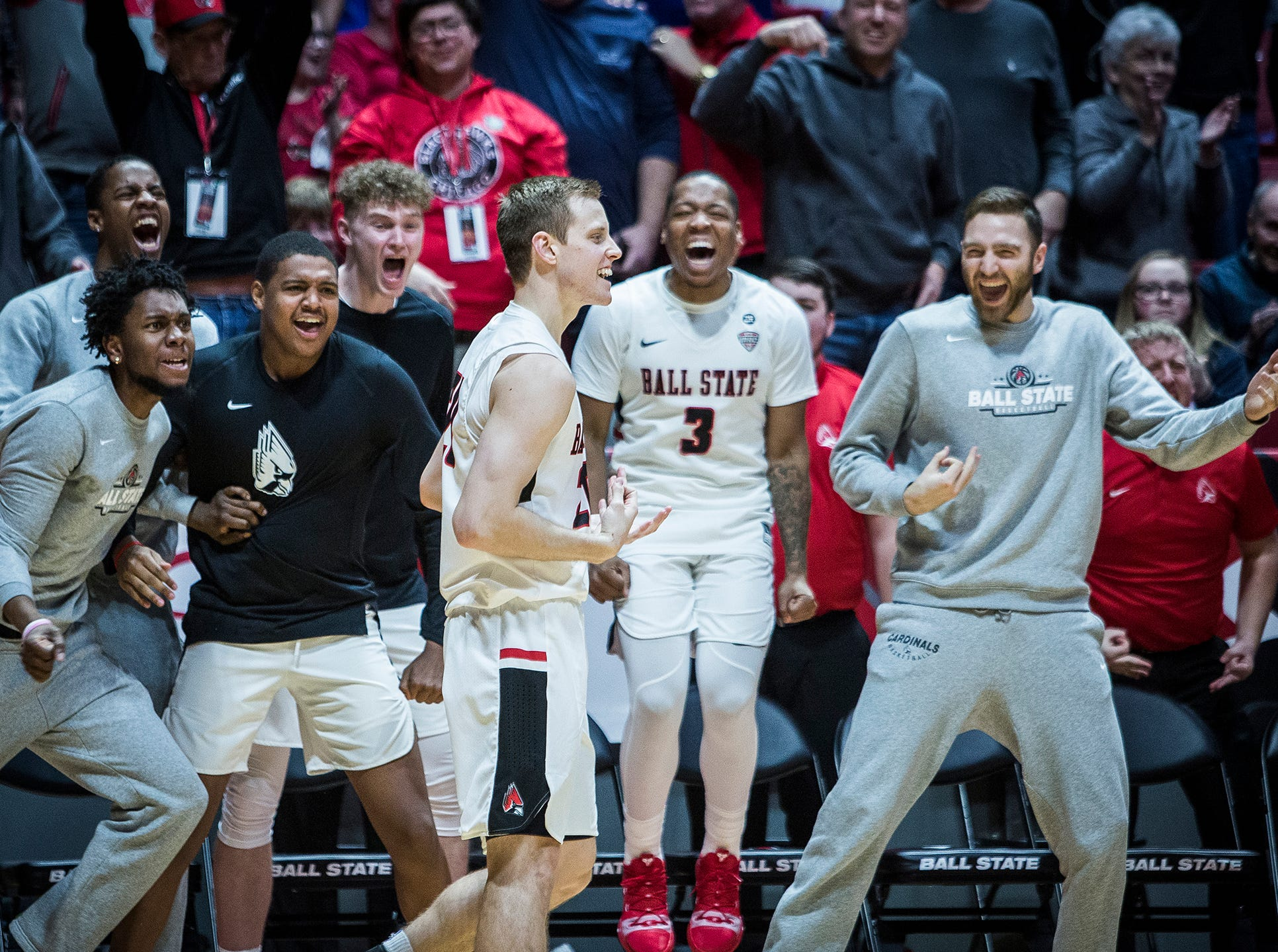 Ball State's Austin Nehls makes a three-pointer against Eastern Michigan's defense during their game at Worthen Arena Tuesday, Jan. 8, 2019.