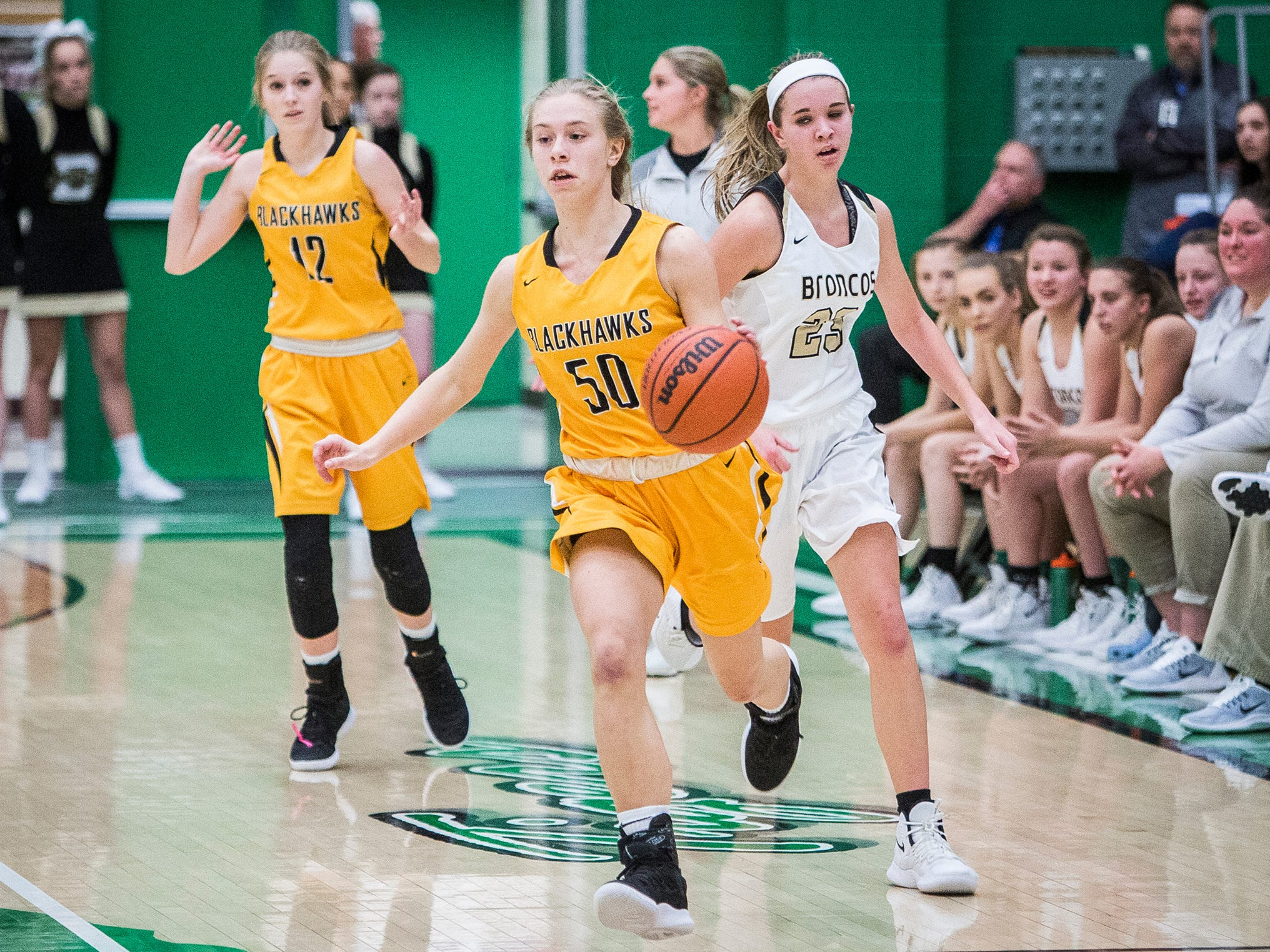 Cowan's Elizabeth Clevenger dribbles past Daleville's defense during their game at Yorktown High School Tuesday, Jan. 8, 2019.