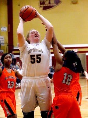 Riverdale's Katelyn Woirley goes up for a shot as Blackman's Nia Vanzant defends Tuesday. Worley scored 10 points in a 60-43 win.