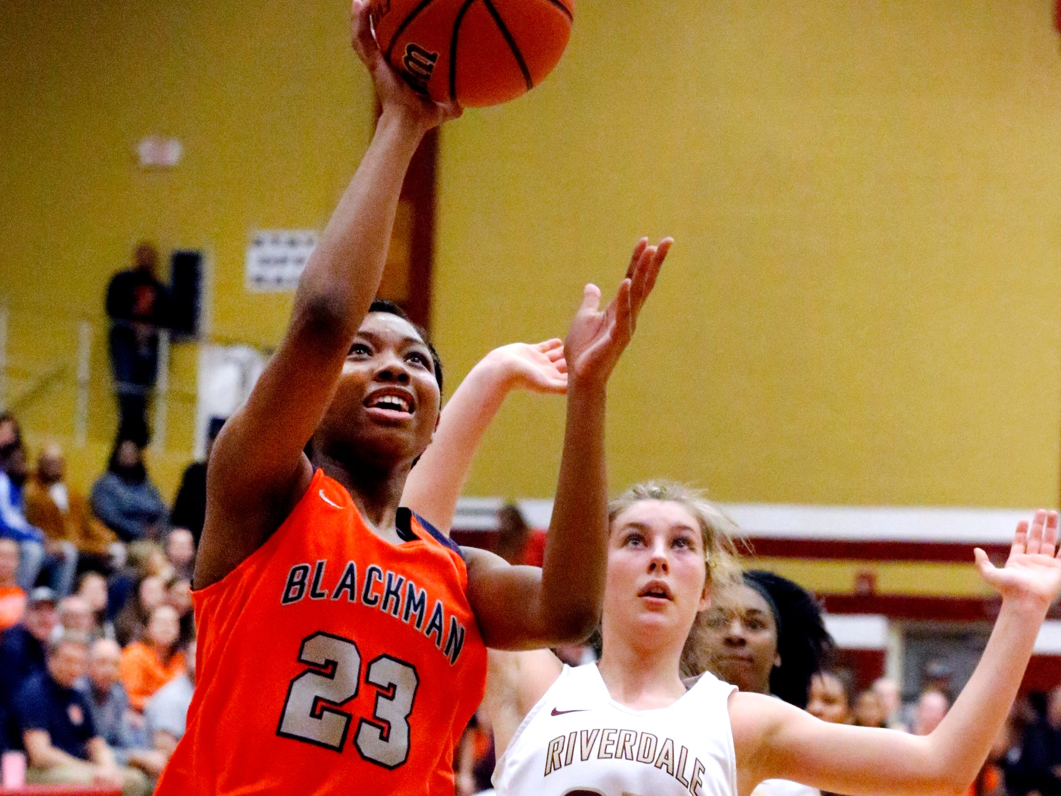 Blackman's Iyana Moore (23) goes up for a shot as Riverdale's Jalyn Hollcomb (23) comes up from behind her on Tuesday Jan. 8, 2019