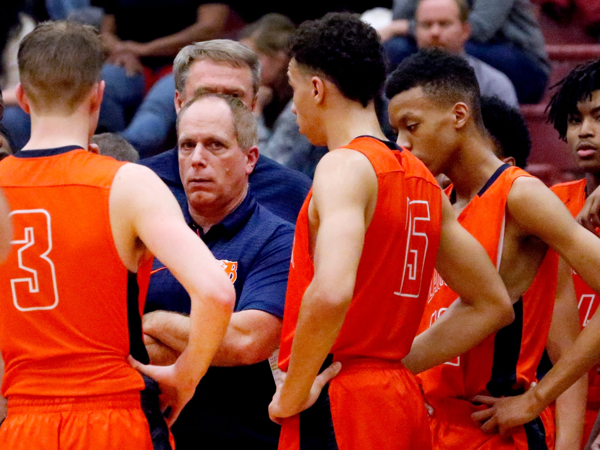 Blackman's head coach Barry Wortman talks with his players during a time out in the game against Riverdale on Tuesday Jan. 8, 2019.