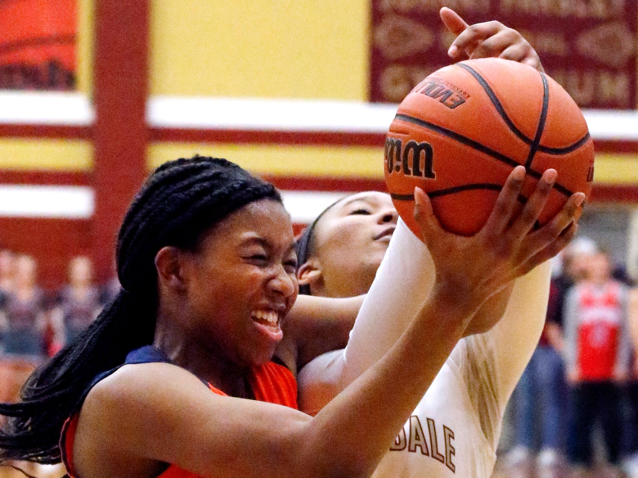 Blackman's Iyana Moore (23) and Riverdale's Alasia Hayes (1) both go after a rebound on Tuesday Jan. 8, 2019.