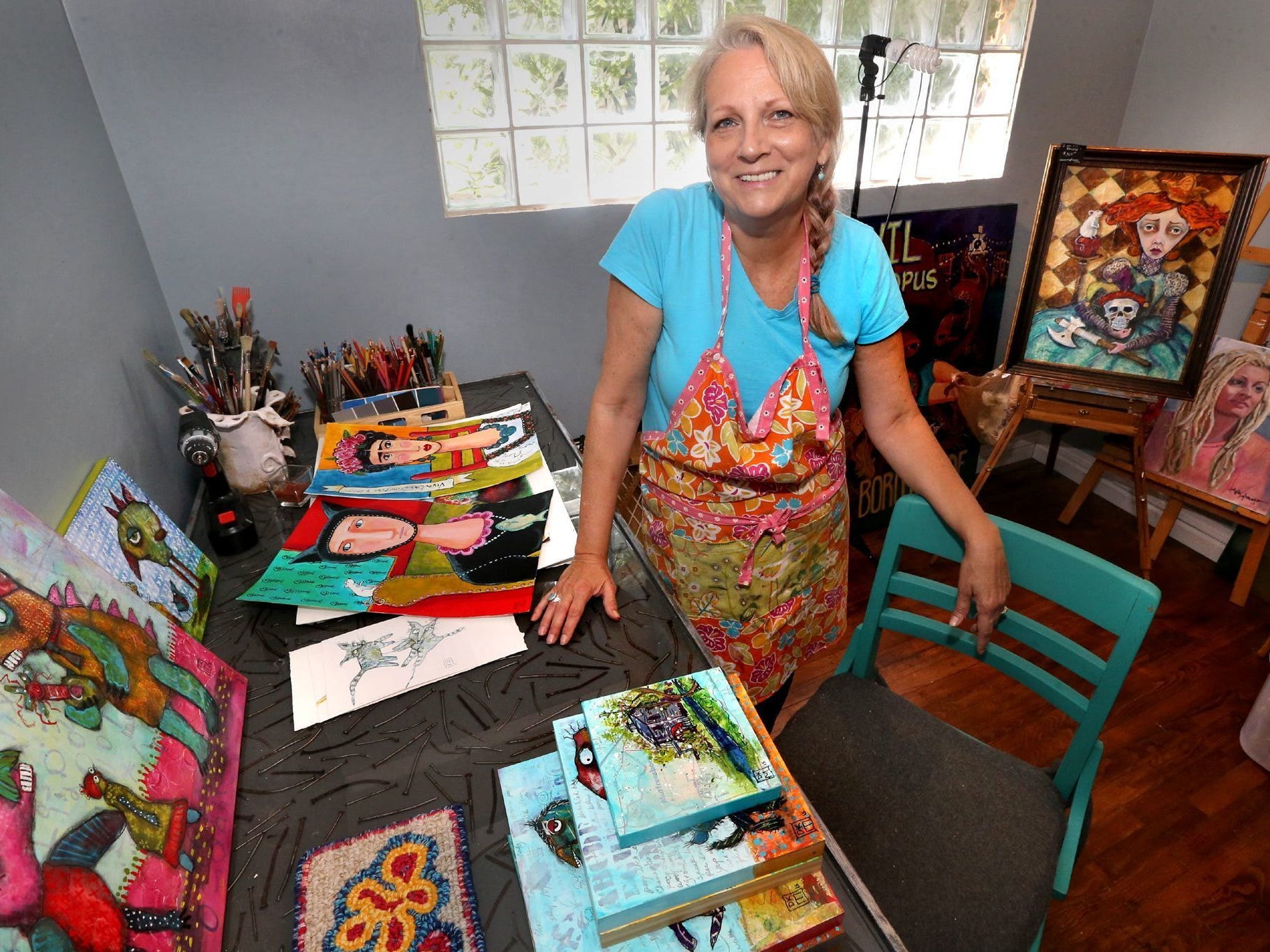 Dawna Magliacano is surrounded by a variety of her works of art in her local studio.