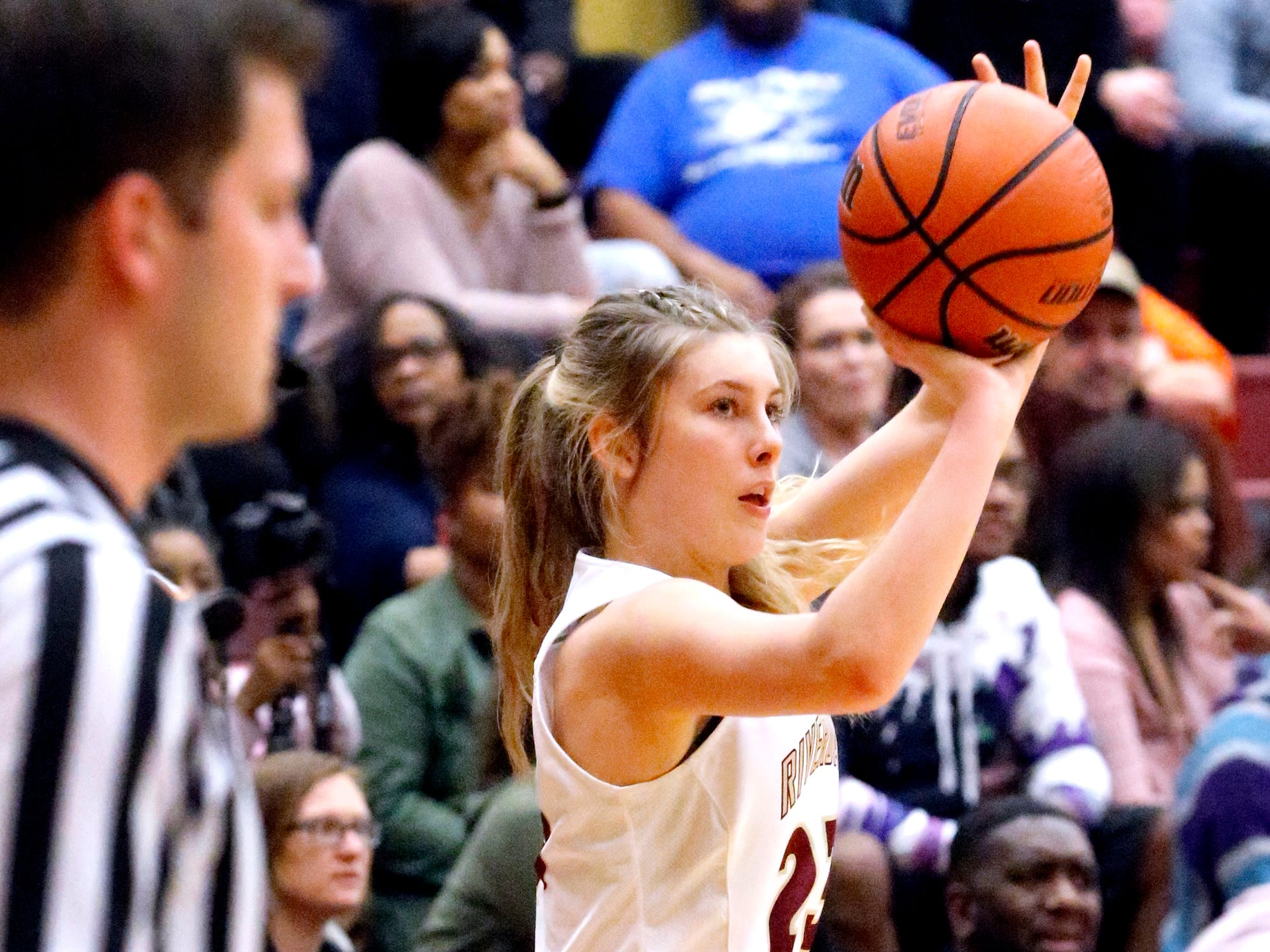 Riverdale's Jalyn Hollcomb (23) shoots a three point basket against Blackman on Tuesday Jan. 8, 2019.