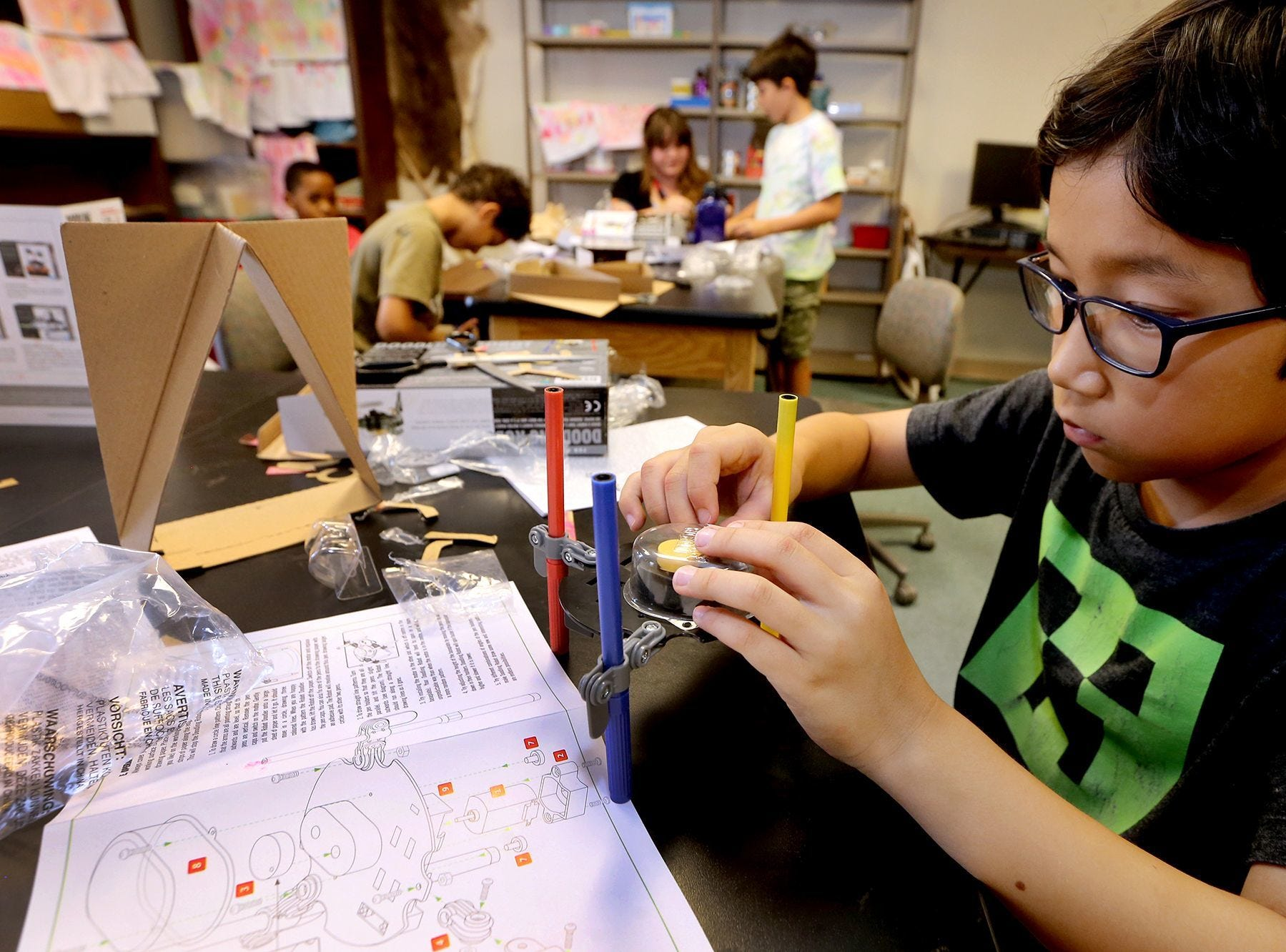 Serik Bilbro builds a model at Camp STEM at MTSU. Art can take many forms, including science.
