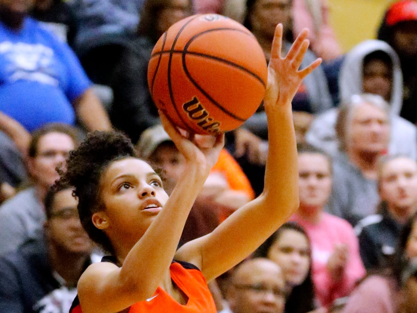 Blackman's Victoria Page (15) shoots a three point basket during a game against Riverdale on Tuesday Jan. 8, 2019.
