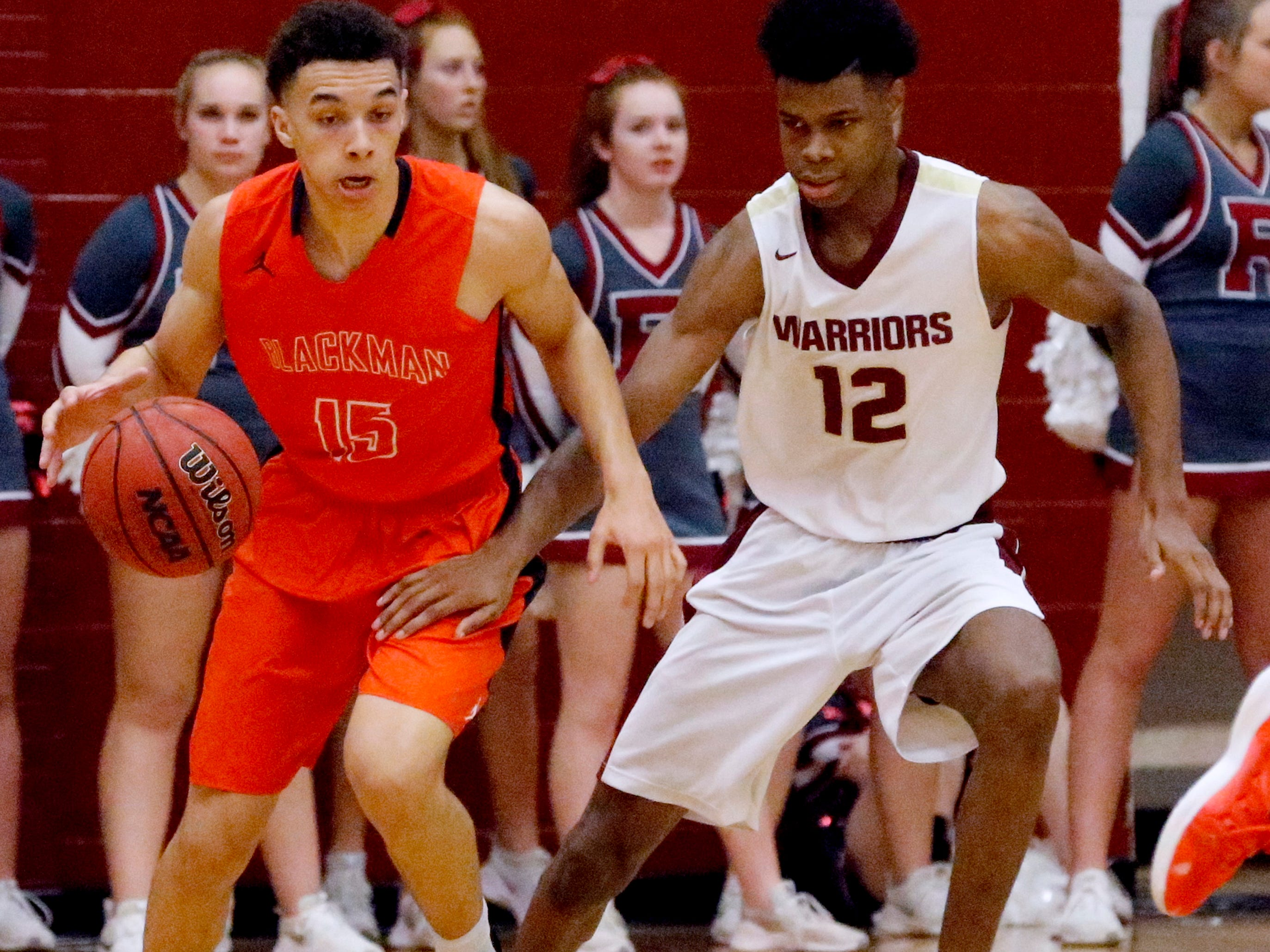 Blackman's Jalen Page (15) brings the ball up the court as Riverdale's Elijah Cobb (12) guards him up the court on Tuesday Jan. 8, 2019.