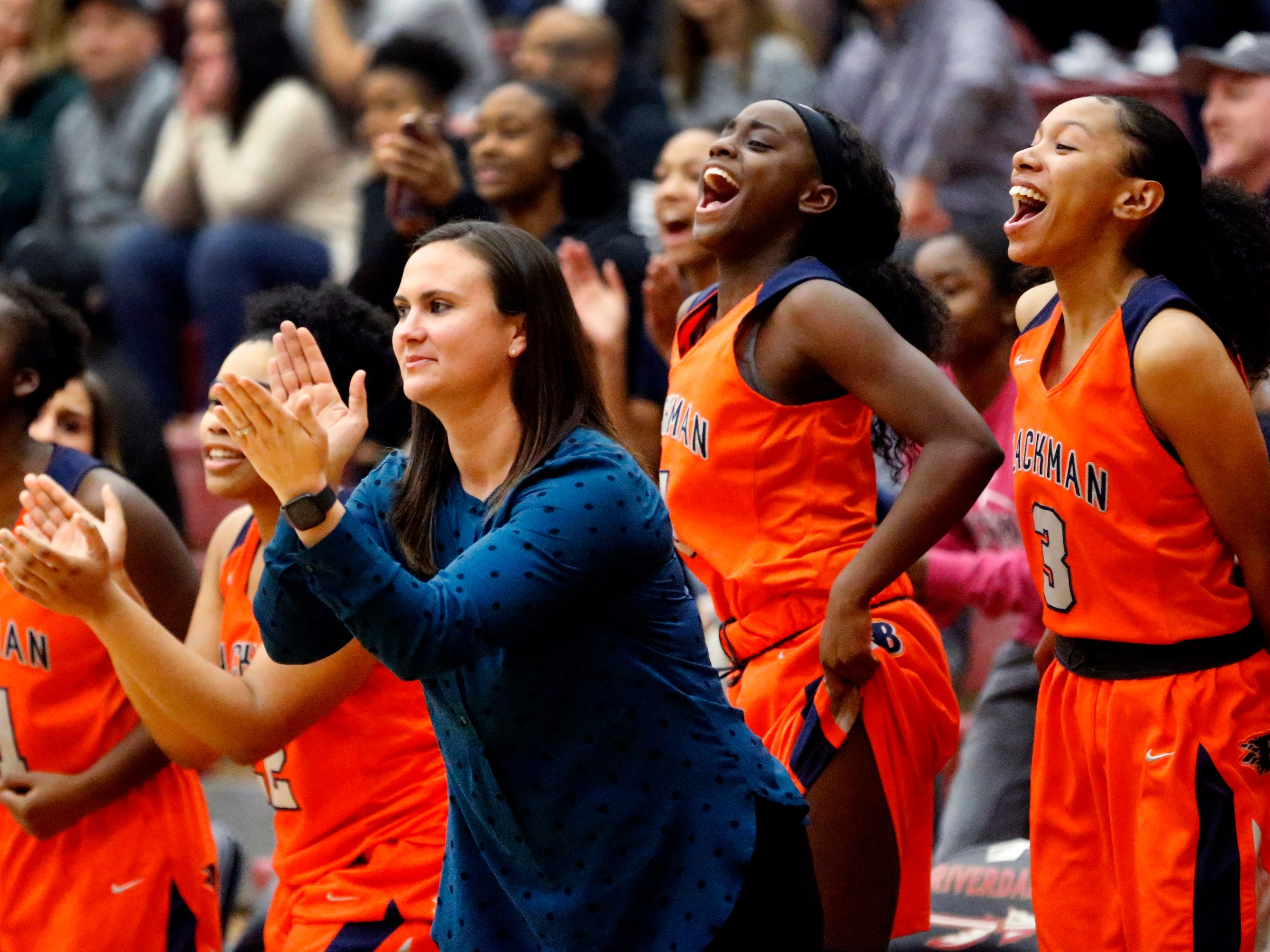 Blackman's head coach Wendi Scott cheers for her team on the sidelines of the game against Riverdale on Tuesday Jan. 8, 2019