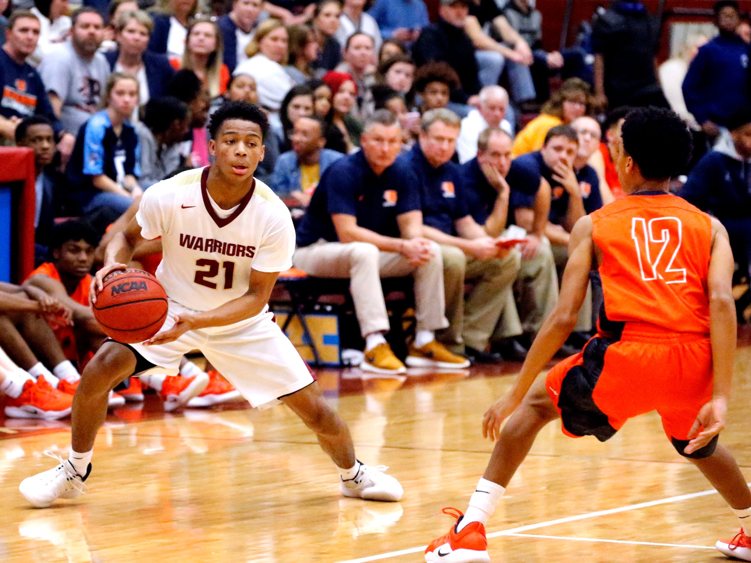 Riverdale's Rashaad Thompson (21) looks for an opening to the basket a Blackman's Mark Cooper (12) guards him on Tuesday Jan. 8, 2019.