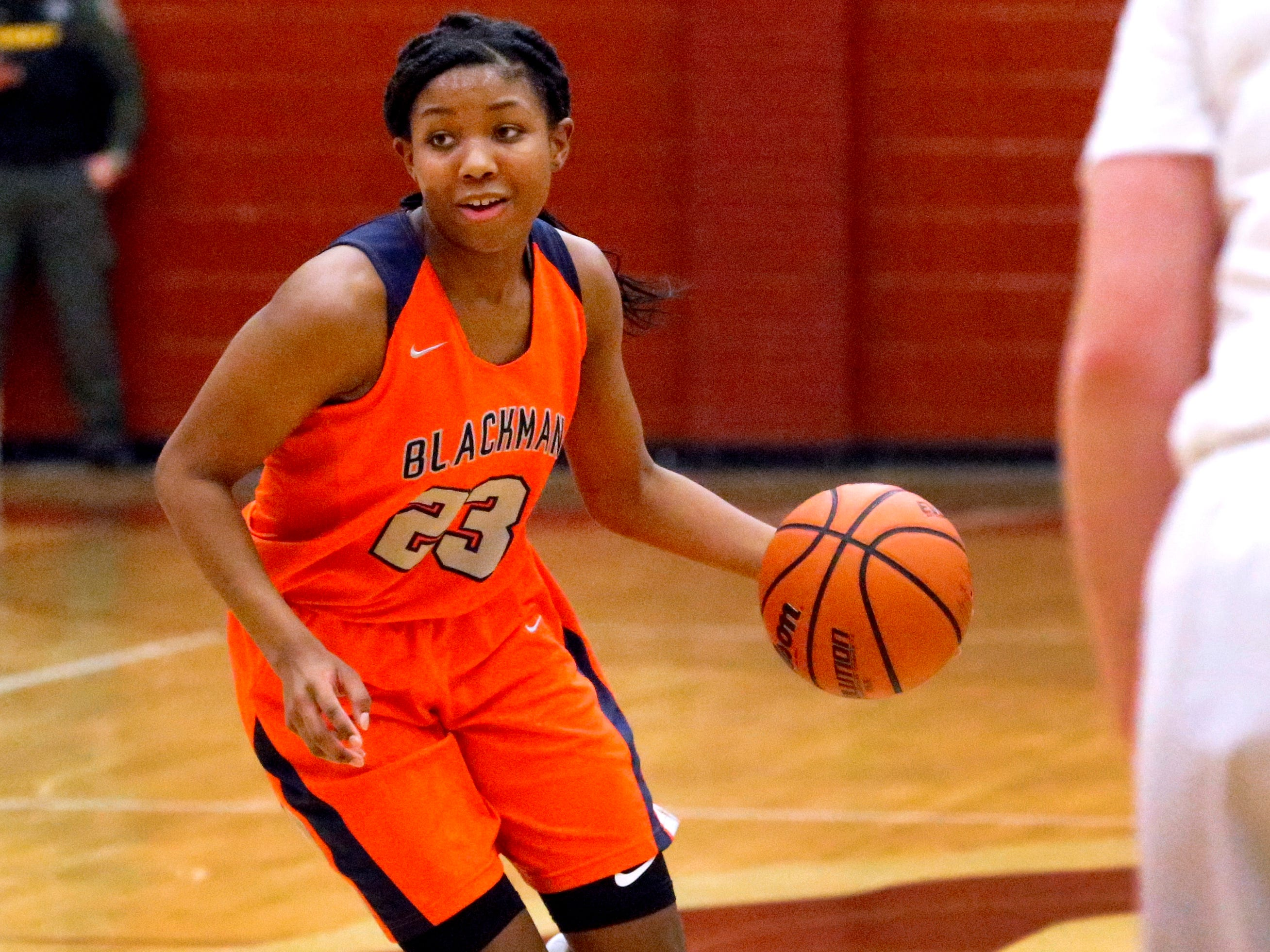 Blackman's Iyana Moore (23) brings the all down the court during the game against Riverdale on Tuesday Jan. 8, 2019.