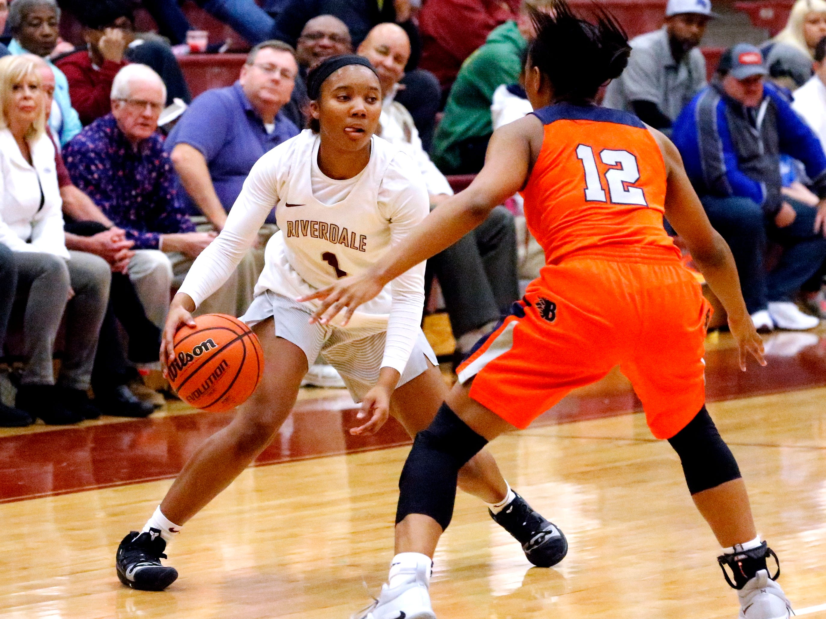 Riverdale's Alasia Hayes (1) moves the ball around the court as Blackman's Nia Vanzant (12) guards her on Tuesday Jan. 8, 2019.