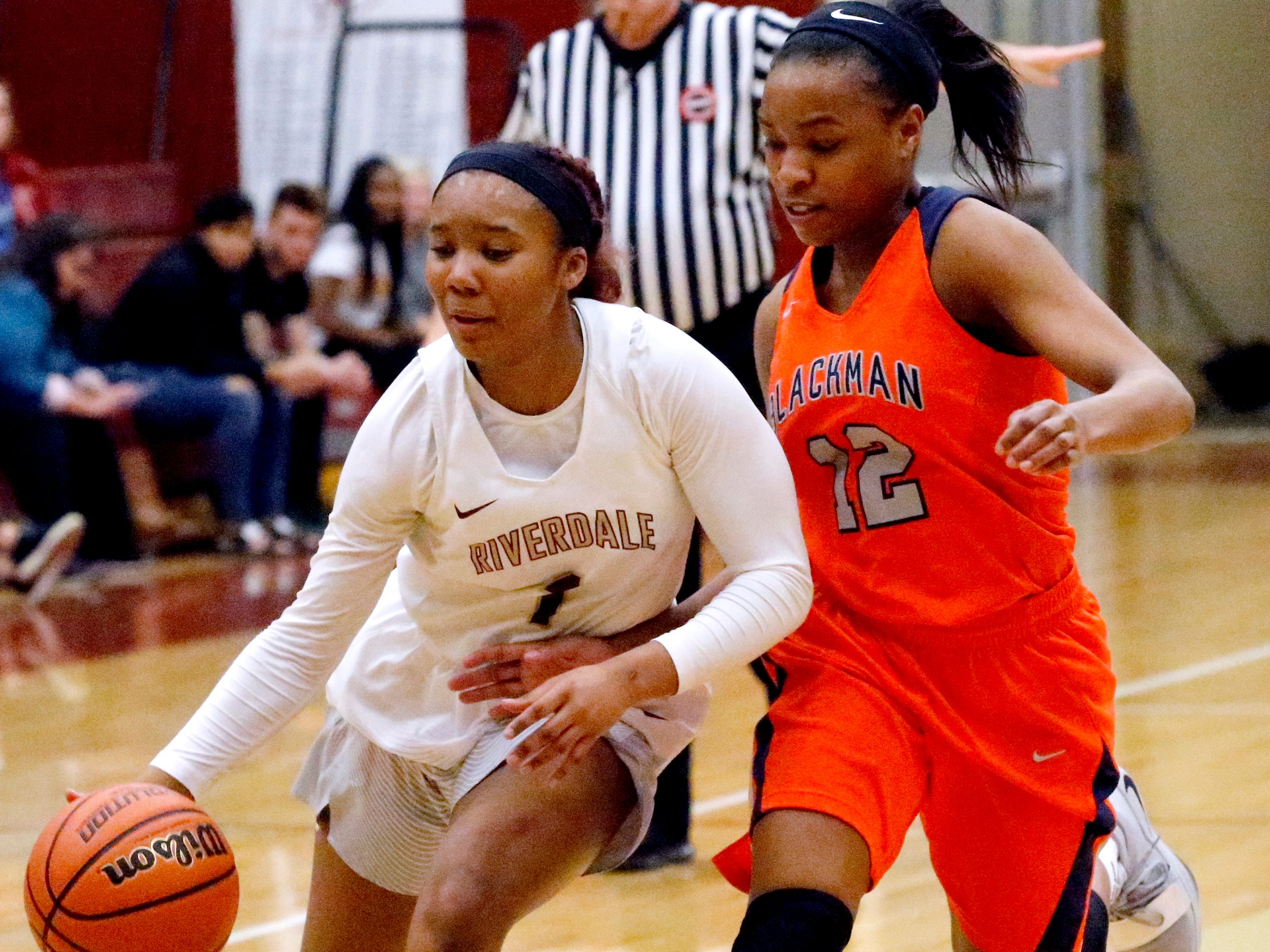 Riverdale's Alasia Hayes (1) heads to the basket as Blackman's Nia Vanzant (12) guards her on Tuesday Jan. 8, 2019