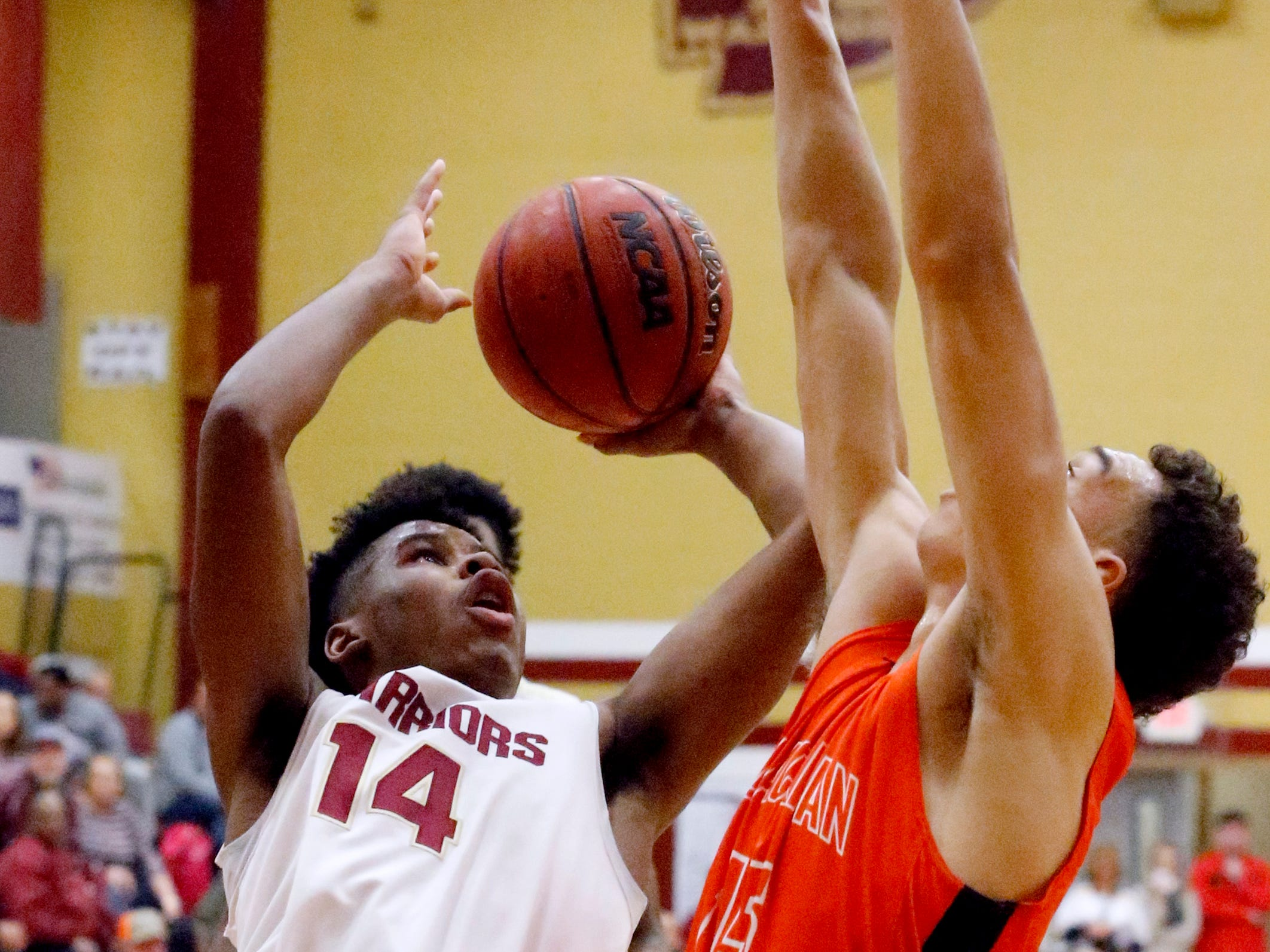 Riverdale's Deron Perry (14) goes up for a shot as Blackman's Jalen Page (15) guards him on Tuesday Jan. 8, 2019.