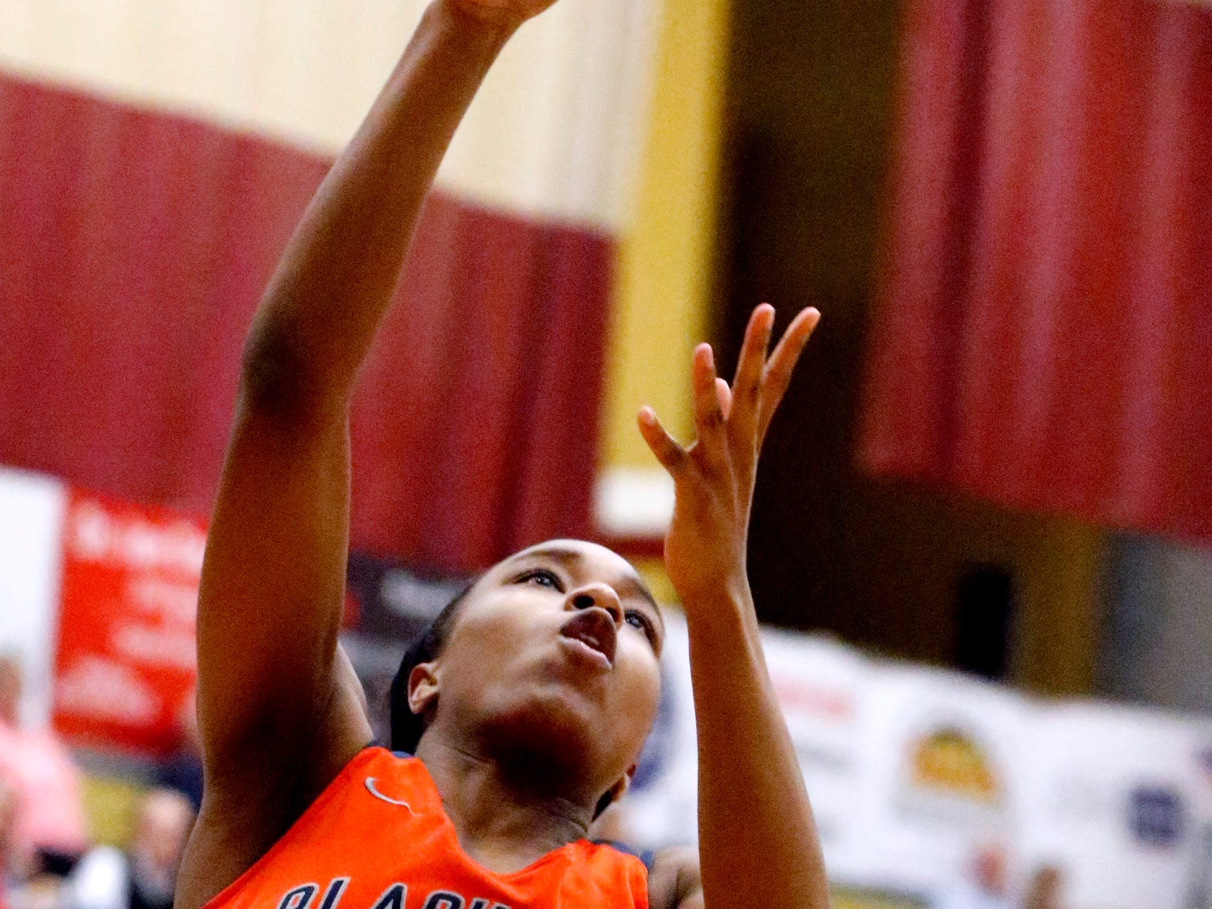 Blackman's Nia Vanzant (12) goes up for a shot against Riverdale on Tuesday Jan. 8, 2019