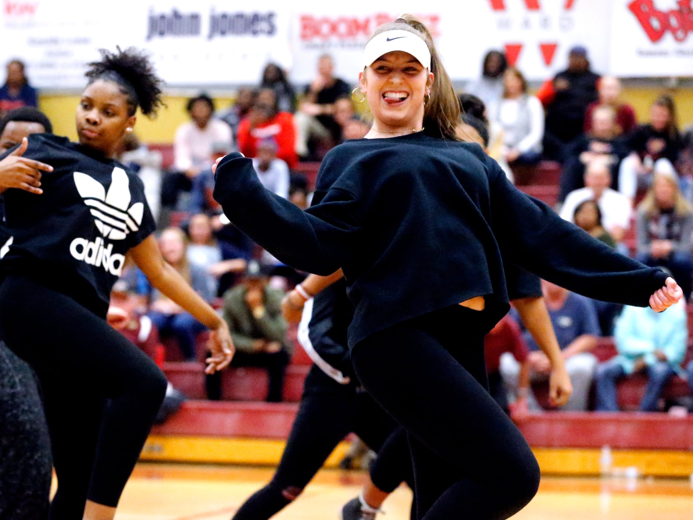 A dance group performs during half-time of the Blackman vs. Riverdale boys basketball game on Tuesday Jan. 8, 2019
