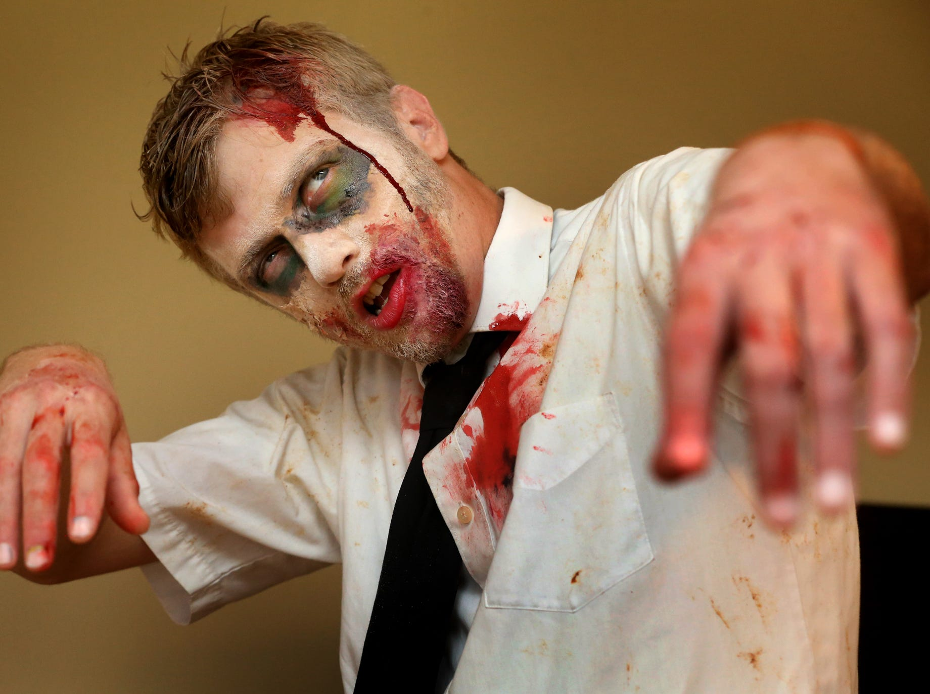 Ryan Frizzell models his zombie look that was created by Sarah Bandy in preparation for the Youth Empowerment through Arts and Humanities Zombie Walk in 2014.