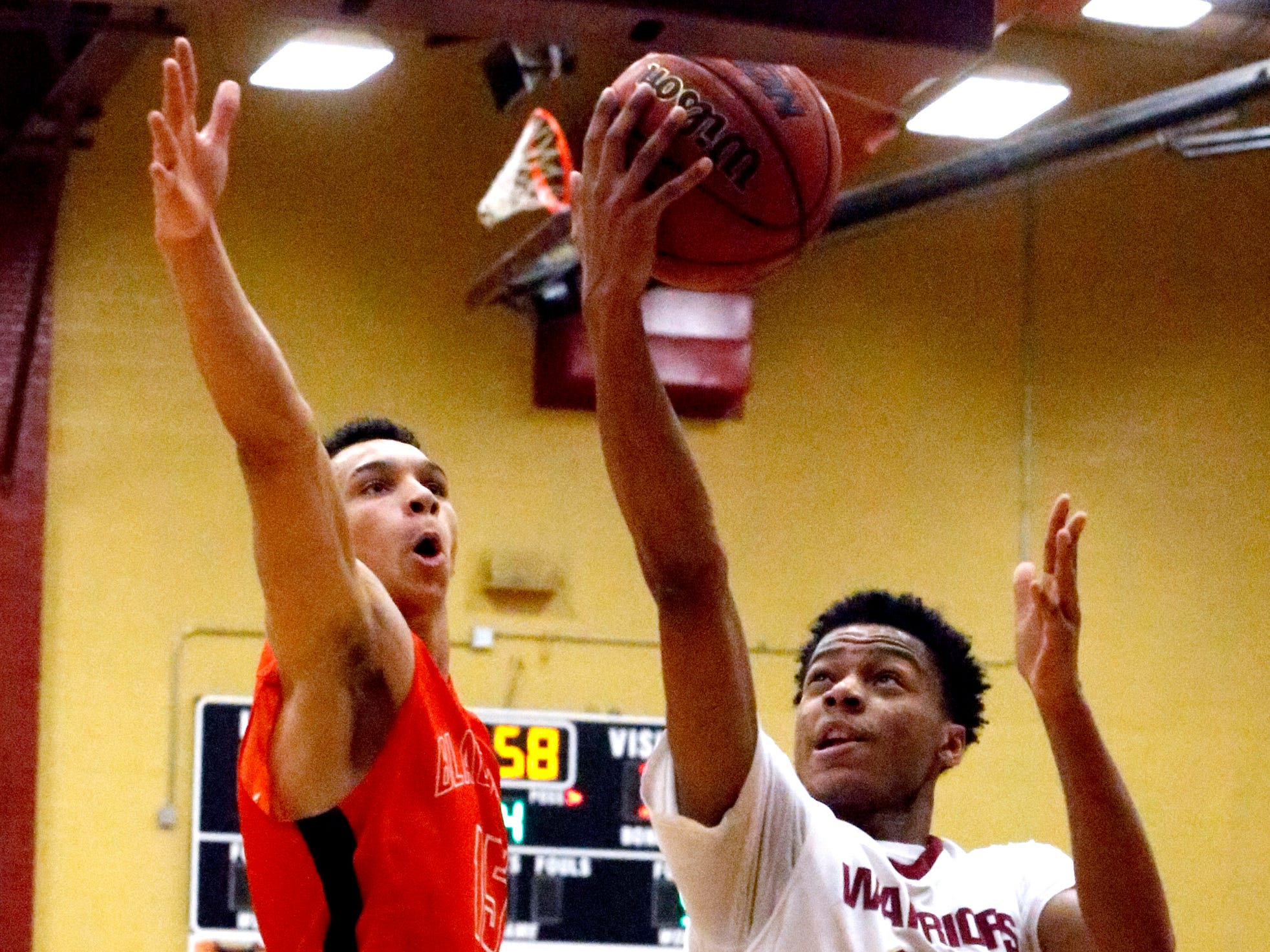 Riverdale's Rashaad Thompson (21) goes up for a shot s Blackman's Jalen Page (15) guards him on Tuesday Jan. 8, 2019.