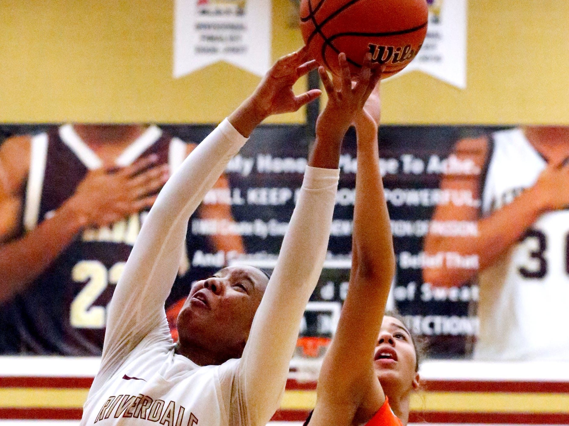 Riverdale's Alasia Hayes (1) and Blackman's Jaida Bond (10) both go for a rebound on Tuesday Jan. 8, 2019