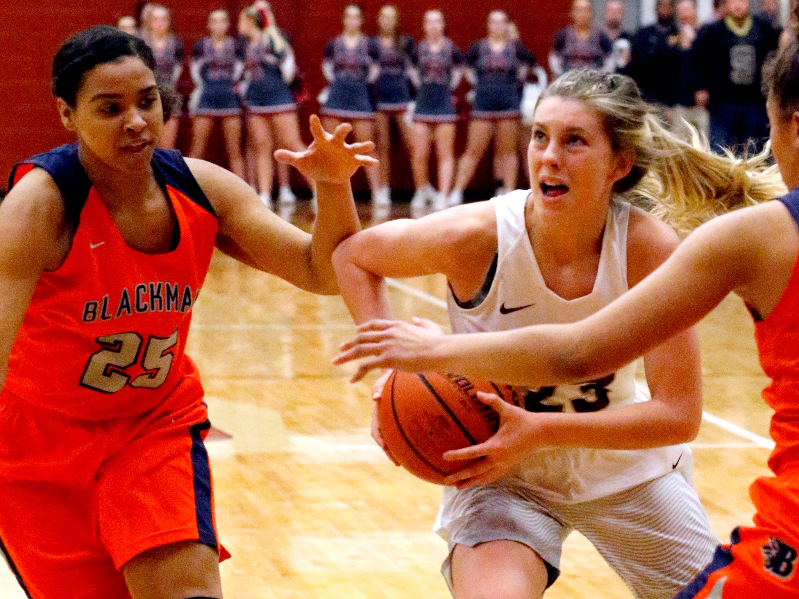 Riverdale's Jalyn Hollcomb (23) pushes to the basket as Blackman's Bri Hay (5) and Blackman's Jaida Bond (10) guard her on Tuesday Jan. 8, 2019