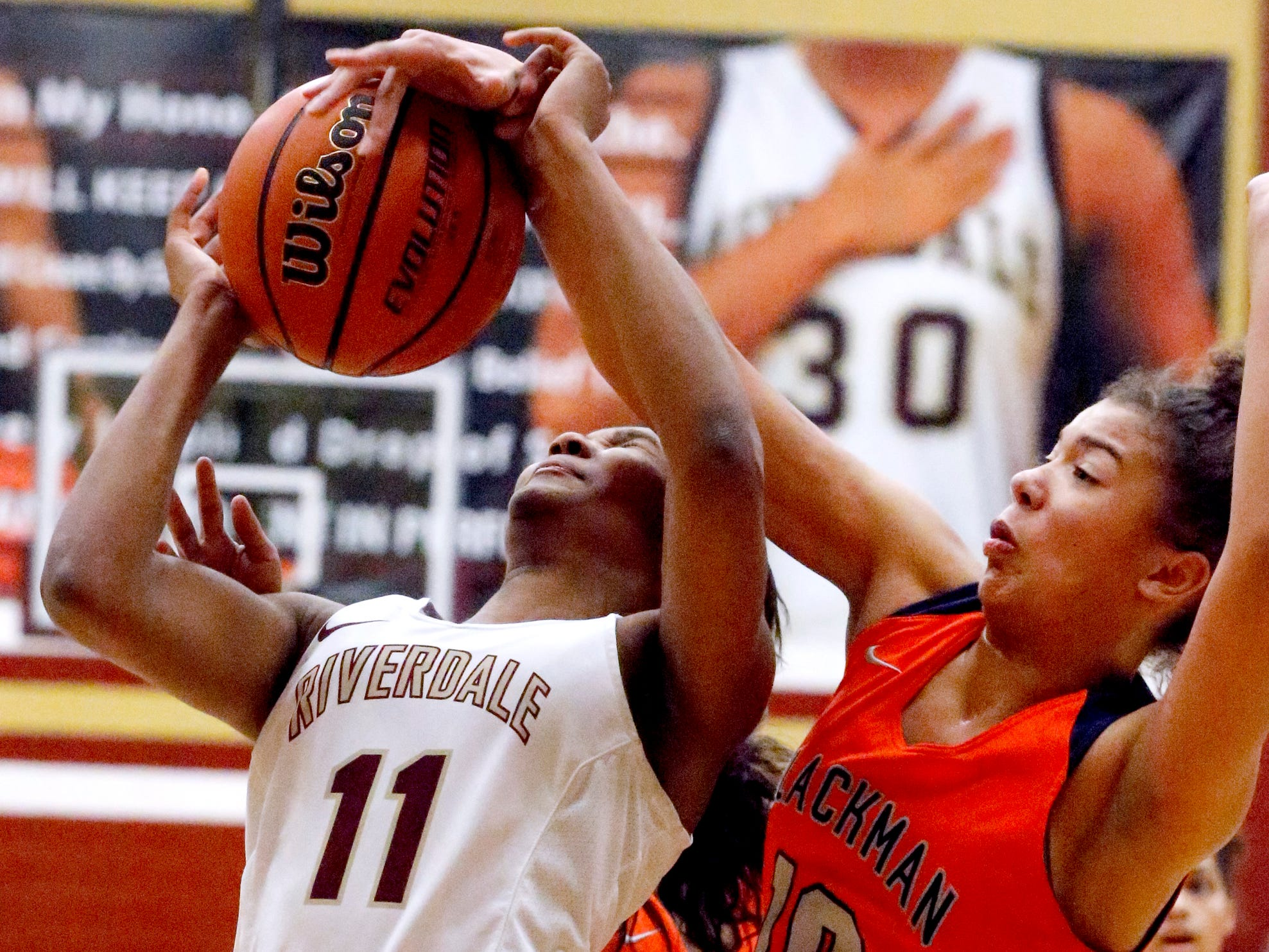 Riverdale's Aislynn Hayes (11) goes up for a shot as Blackman's Jaida Bond (10) guards her on Tuesday Jan. 8, 2019