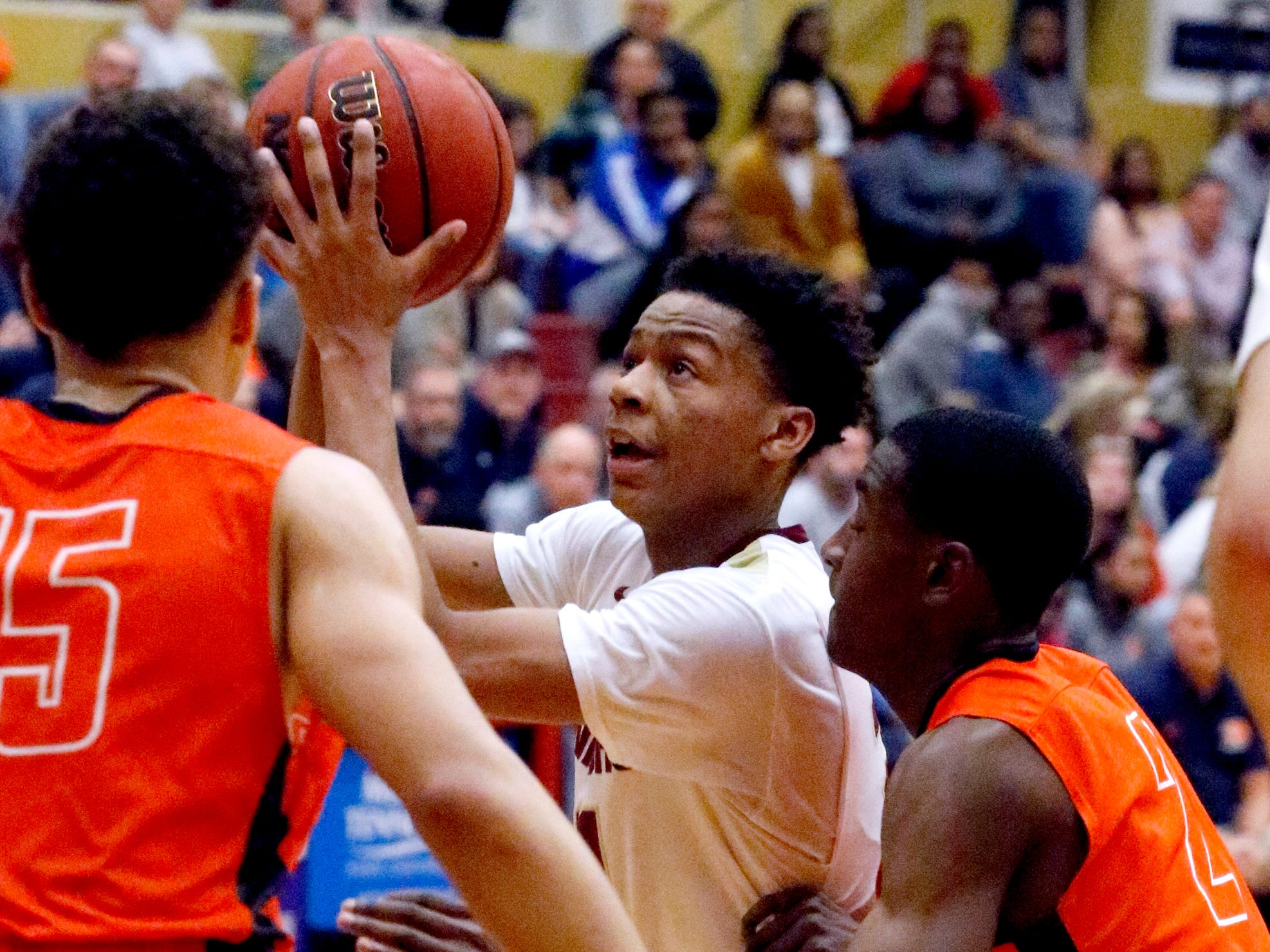 Riverdale's Rashaad Thompson (21) goes up for a shot between Blackman's Jalen Page (15) and Zoryn Harrington (2) on Tuesday Jan. 8, 2019.