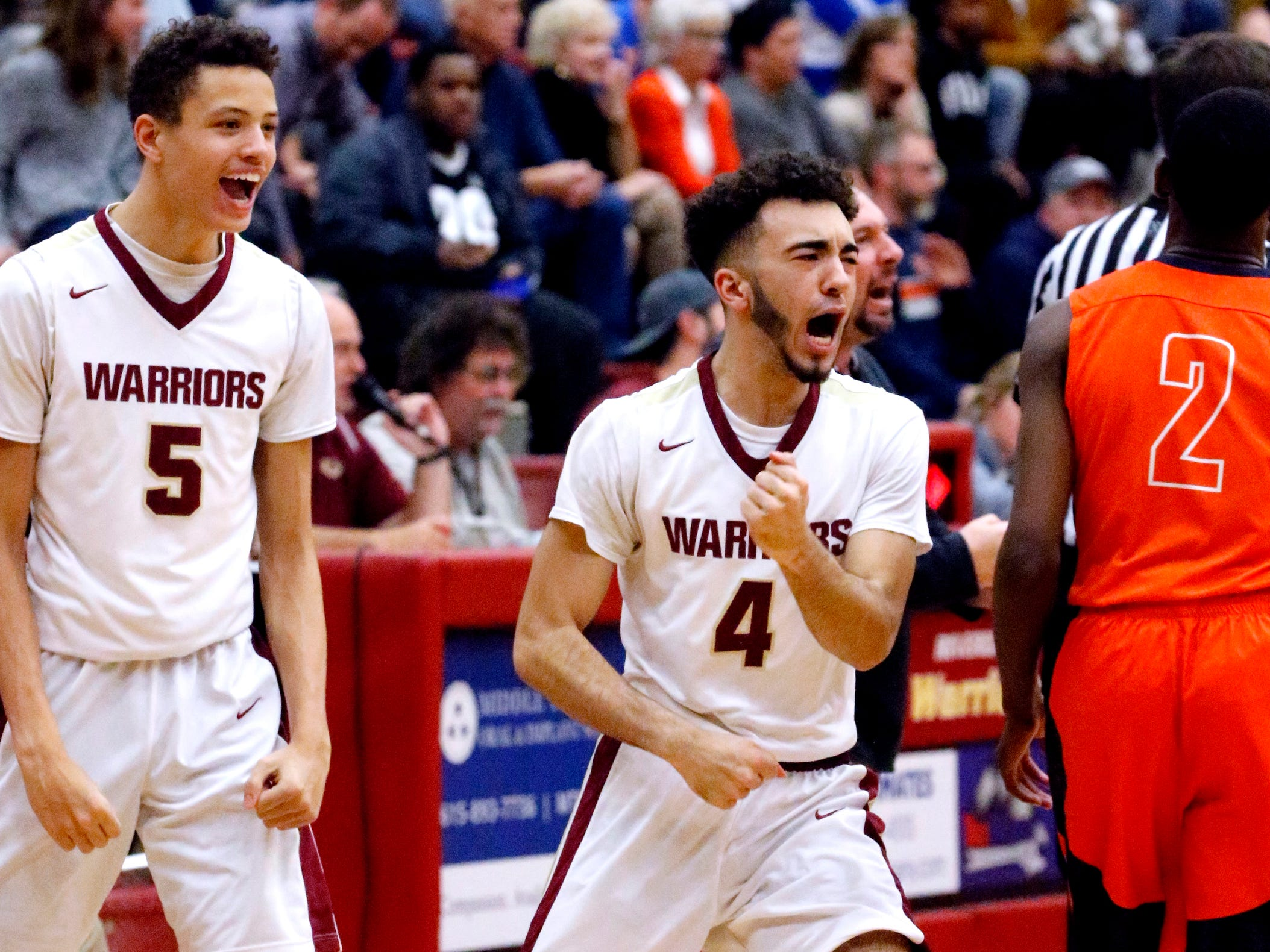 Riverdale's Kai Crawford (4) celebrates a play as the team comes in for a time-out during the game against Blackman on Tuesday Jan. 8, 2019.