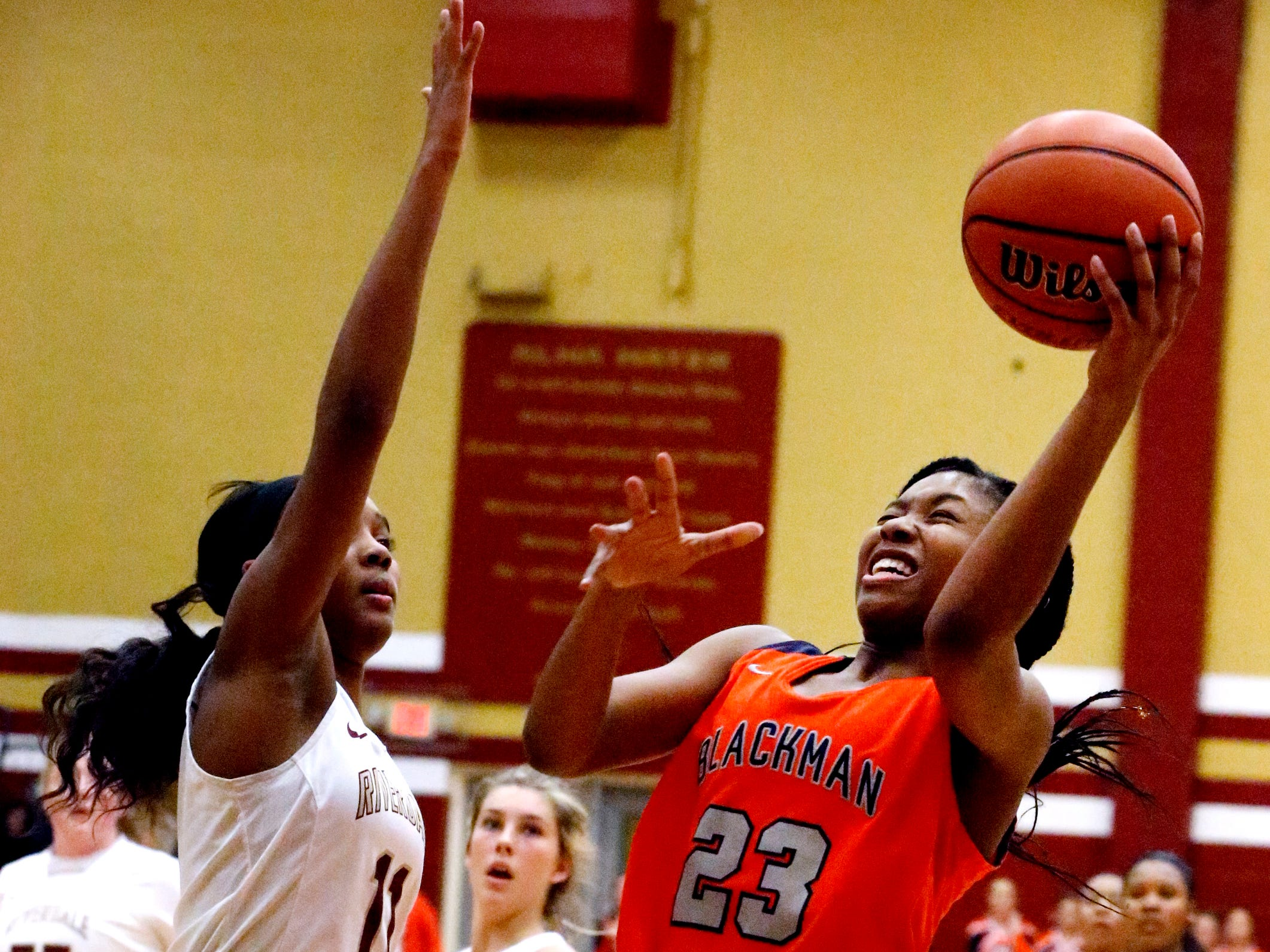 Blackman's Iyana Moore (23) goes up for a shot as Riverdale's Aislynn Hayes (11) guards her on Tuesday Jan. 8, 2019.