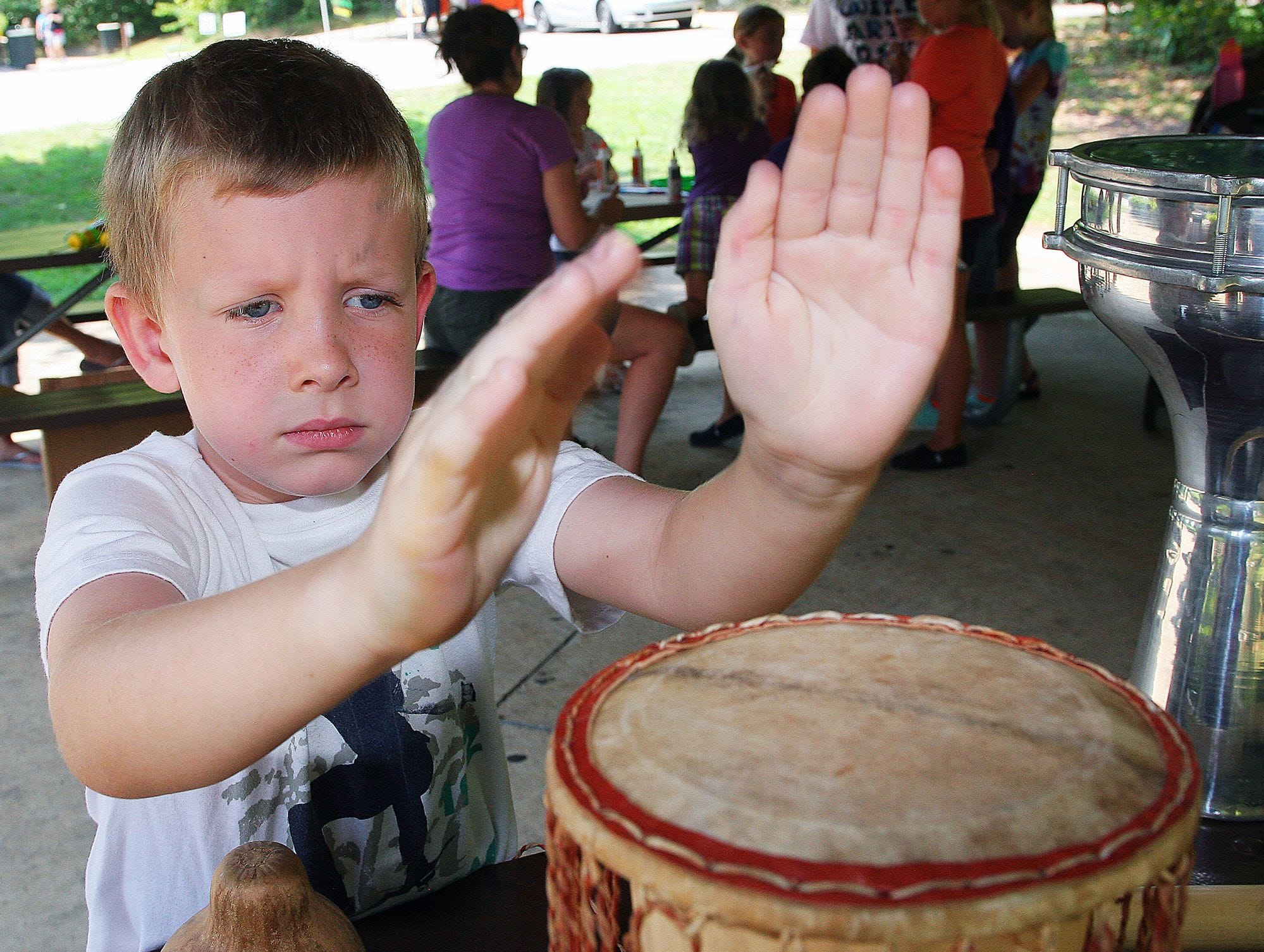 Sean McKim, a student at Rockvale Elementary School, takes advantage of the many different instruments at a past Wild Arts Day at Wilderness Station.