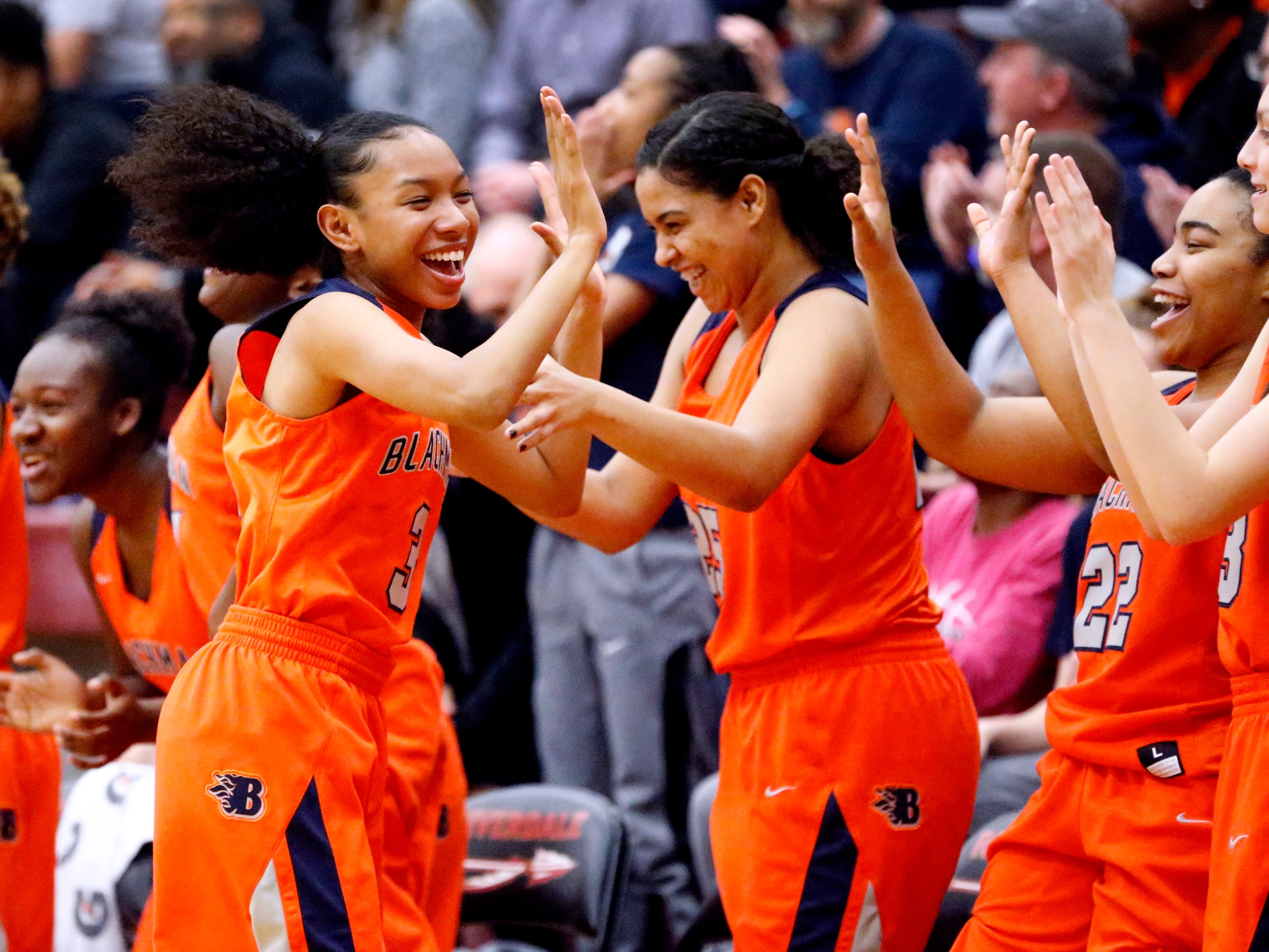 Blackman's Nya Caruthers (3) celebrates a three point basket made by Blackman's Jaida Bond (10) on Tuesday Jan. 8, 2019 during a game against Riverdale.