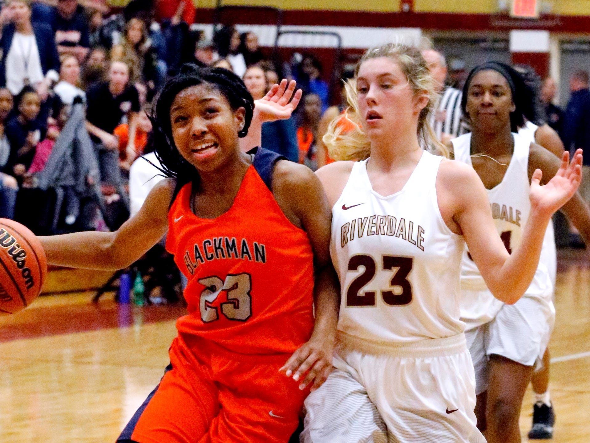 Blackman's Iyana Moore (23) goes up for a shot as Riverdale's Jalyn Hollcomb (23) guards her on Tuesday Jan. 8, 2019.