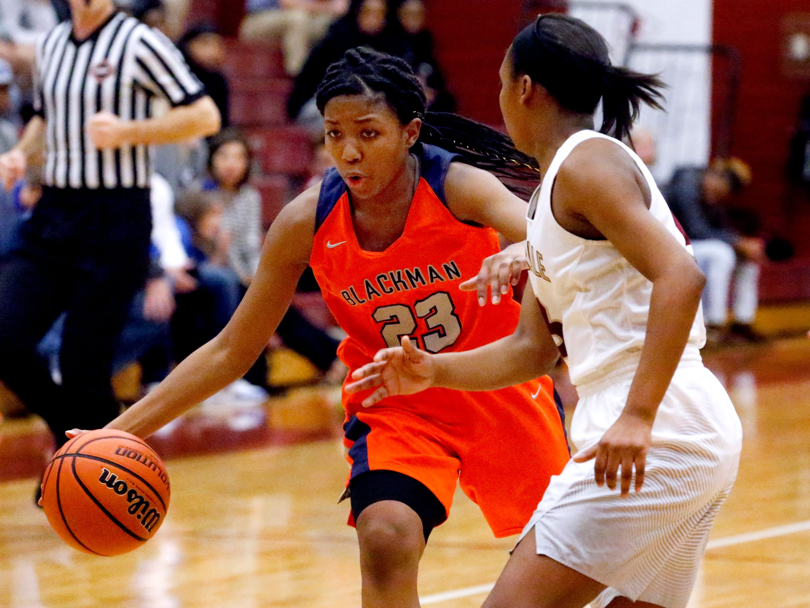 Blackman's Iyana Moore (23) pushes to the basket as Riverdale's Aislynn Hayes (11) guards her on Tuesday Jan. 8, 2019.