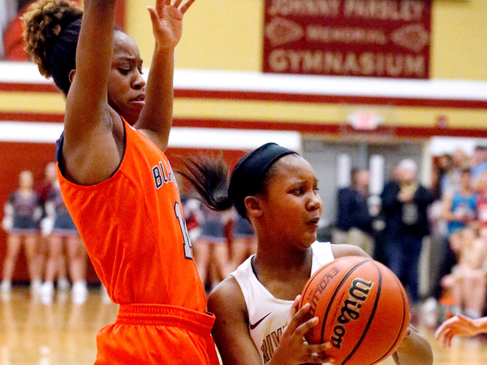 Riverdale's Acacia Hayes (3) looks to pass the ball as Blackman's Joelle Patton (14) guards her on Tuesday Jan. 8, 2019