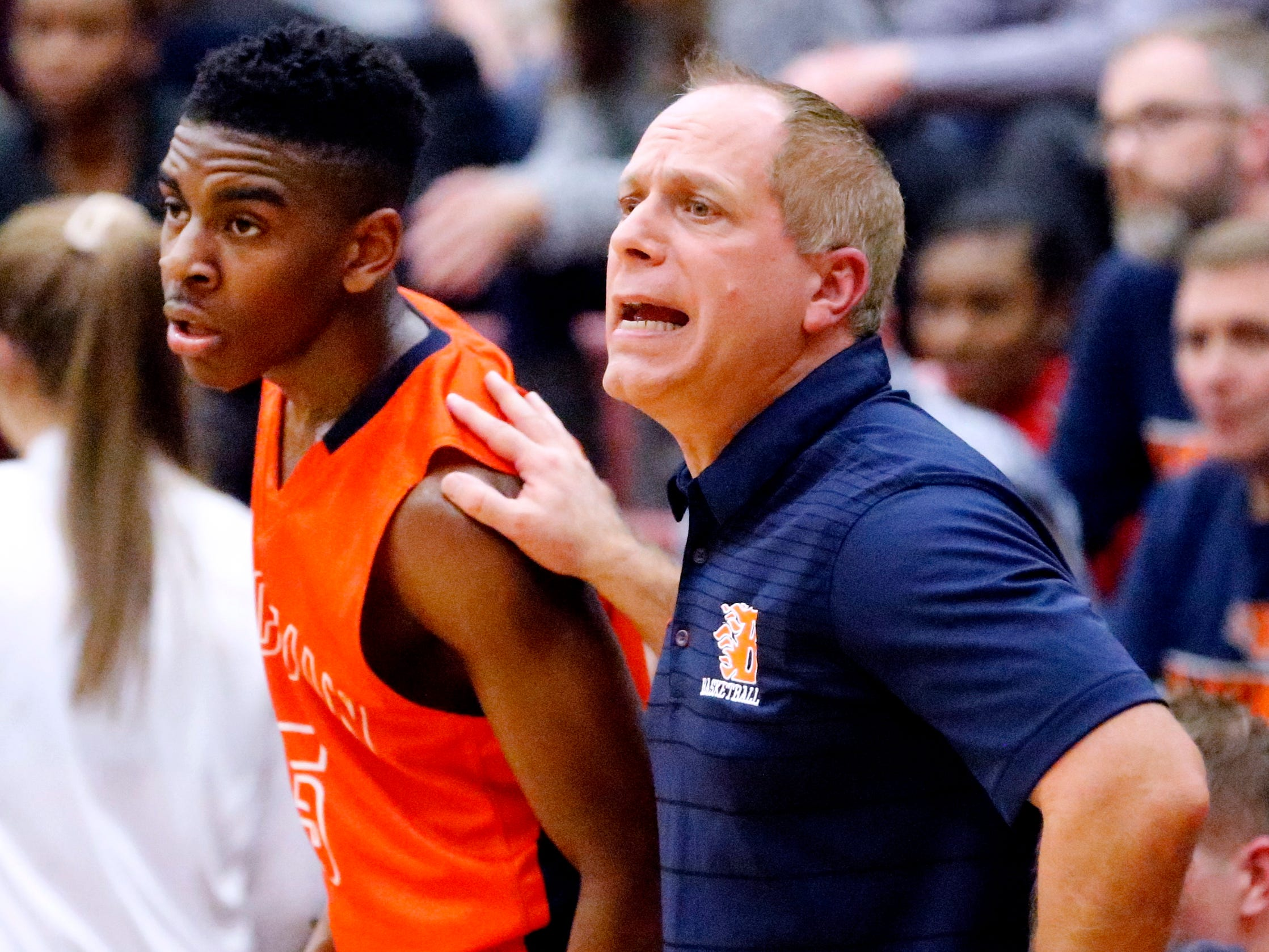 Blackman's head coach Barry Wortman stands next to Blackman's Jacquari Johnson (5) as he coaches on the sidelines on Tuesday Jan. 8, 2019 during the game against Riverdale.