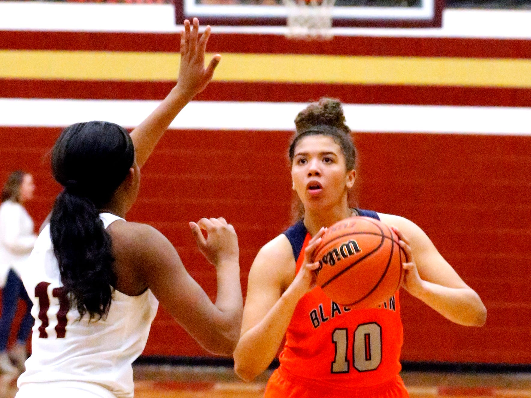 Blackman's Jaida Bond (10) goes for a three point basket as Riverdale's Aislynn Hayes (11) guards her on Tuesday Jan. 8, 2019.