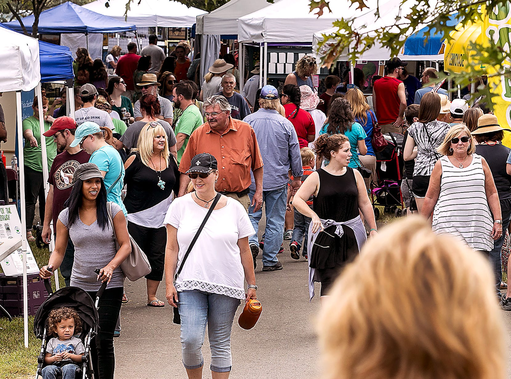 A large crowd fills the Murfreesboro Greenway at Old Fort Park for the annual Greenway Art Festival.